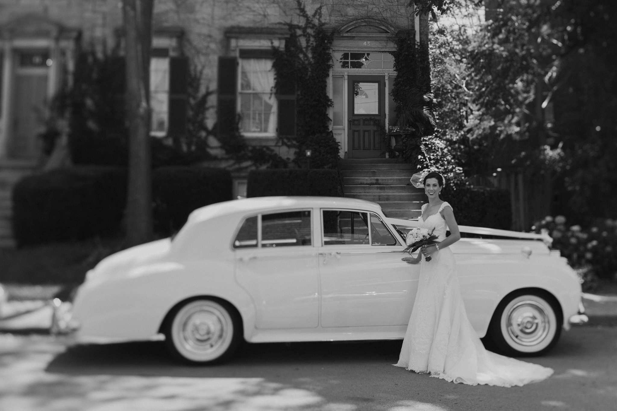 Portrait of bride in front of Rolls Royce