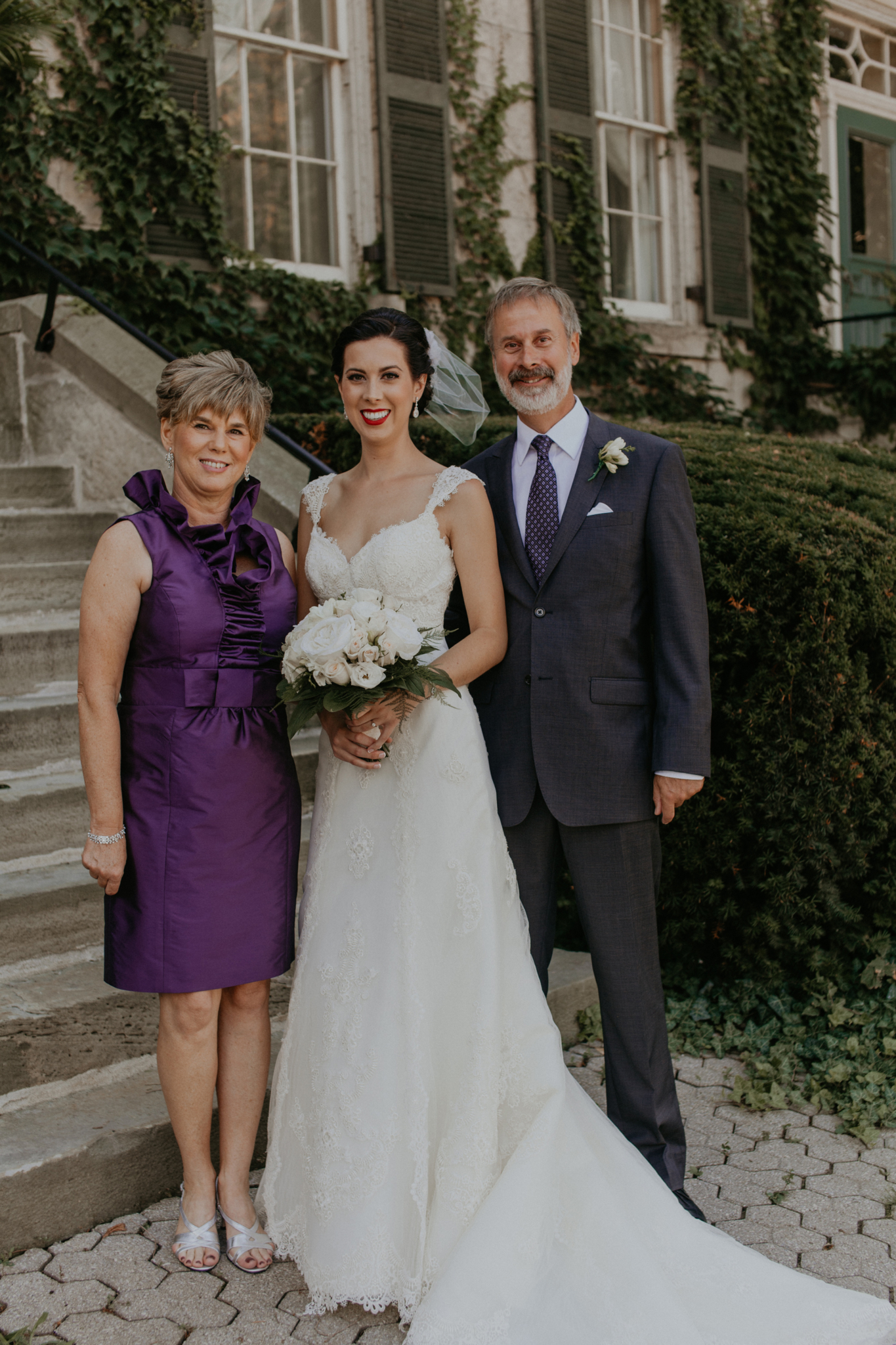 Portrait of bride with mother and father of bride