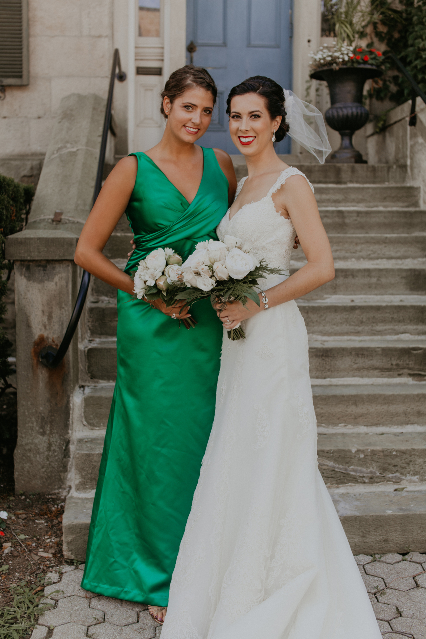 Portrait of bride with bridesmaid in green dress