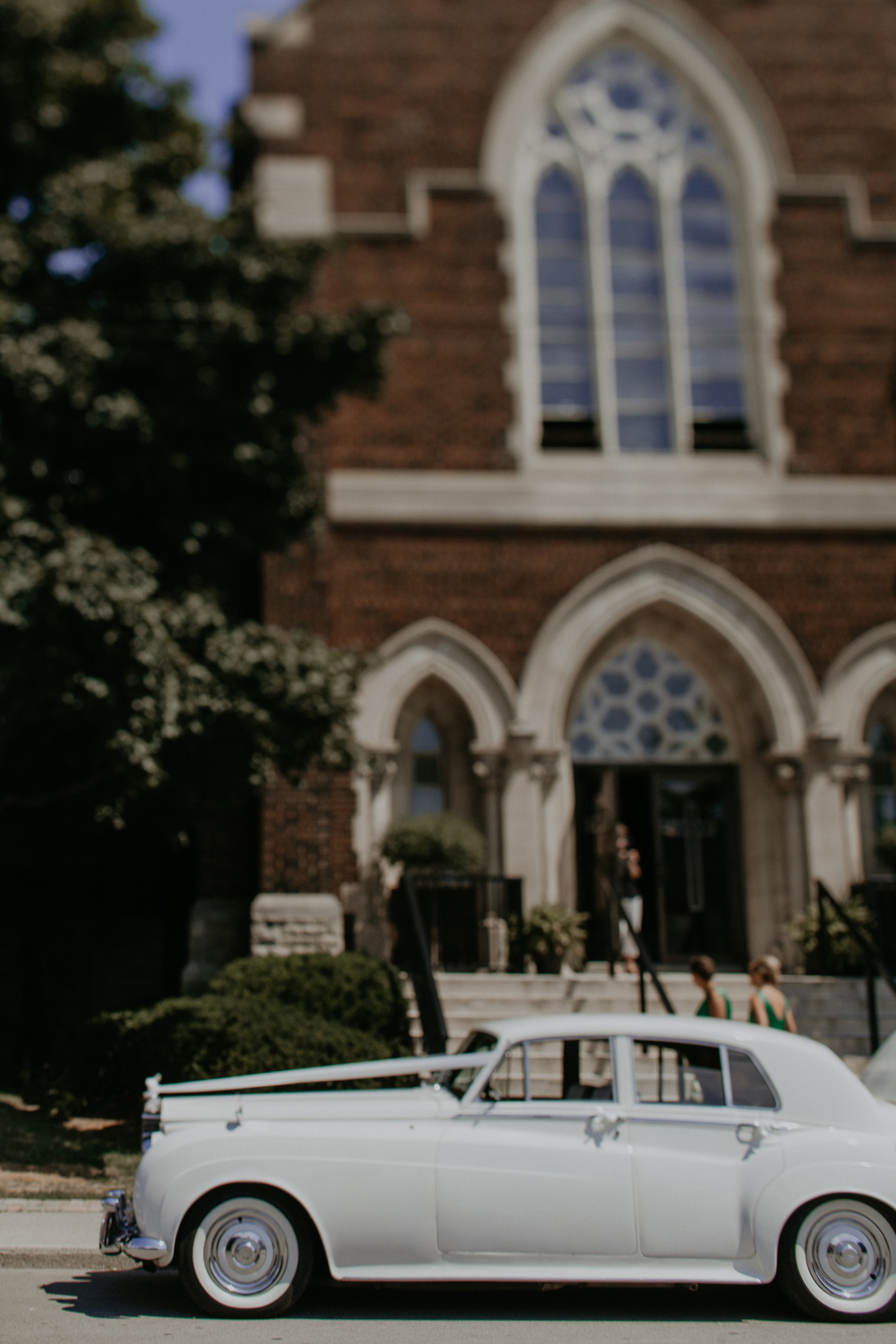 Rolls Royce parked outside church at wedding ceremony