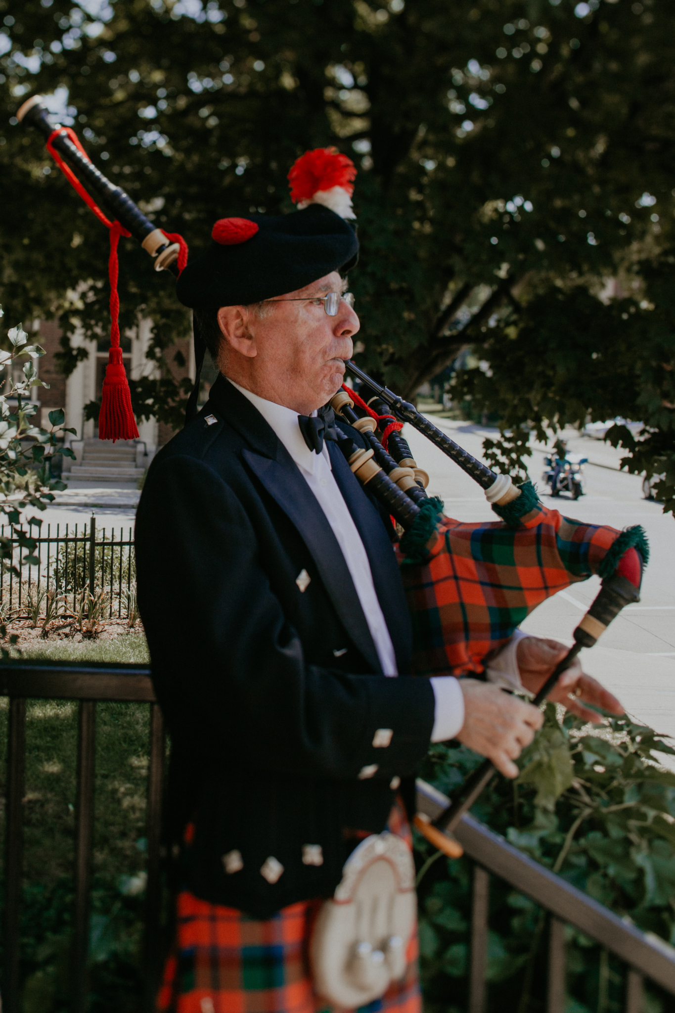 Scottish bagpiper playing bagpipes at wedding ceremony Minneapolis MN