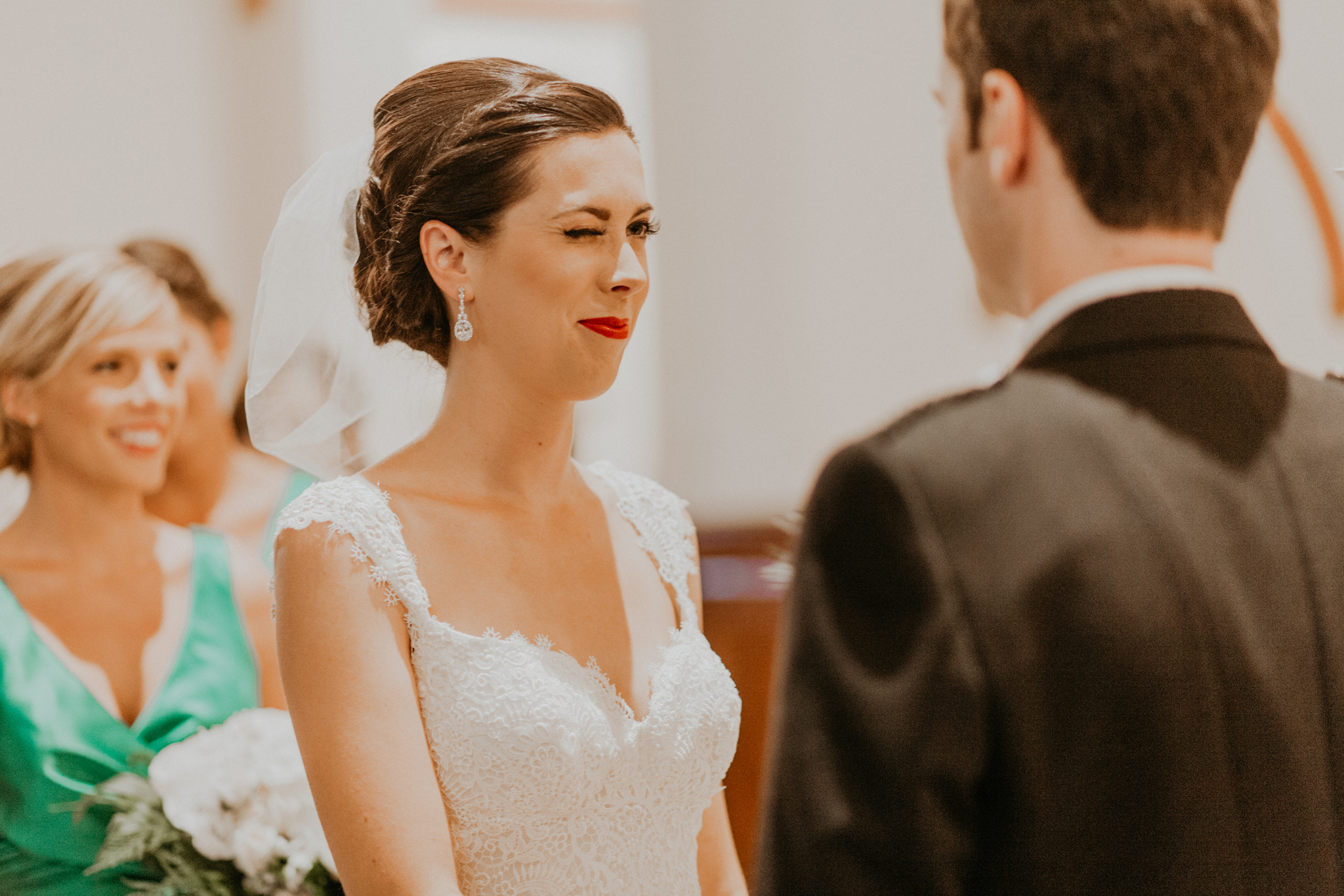 Bride winks at groom during wedding ceremony
