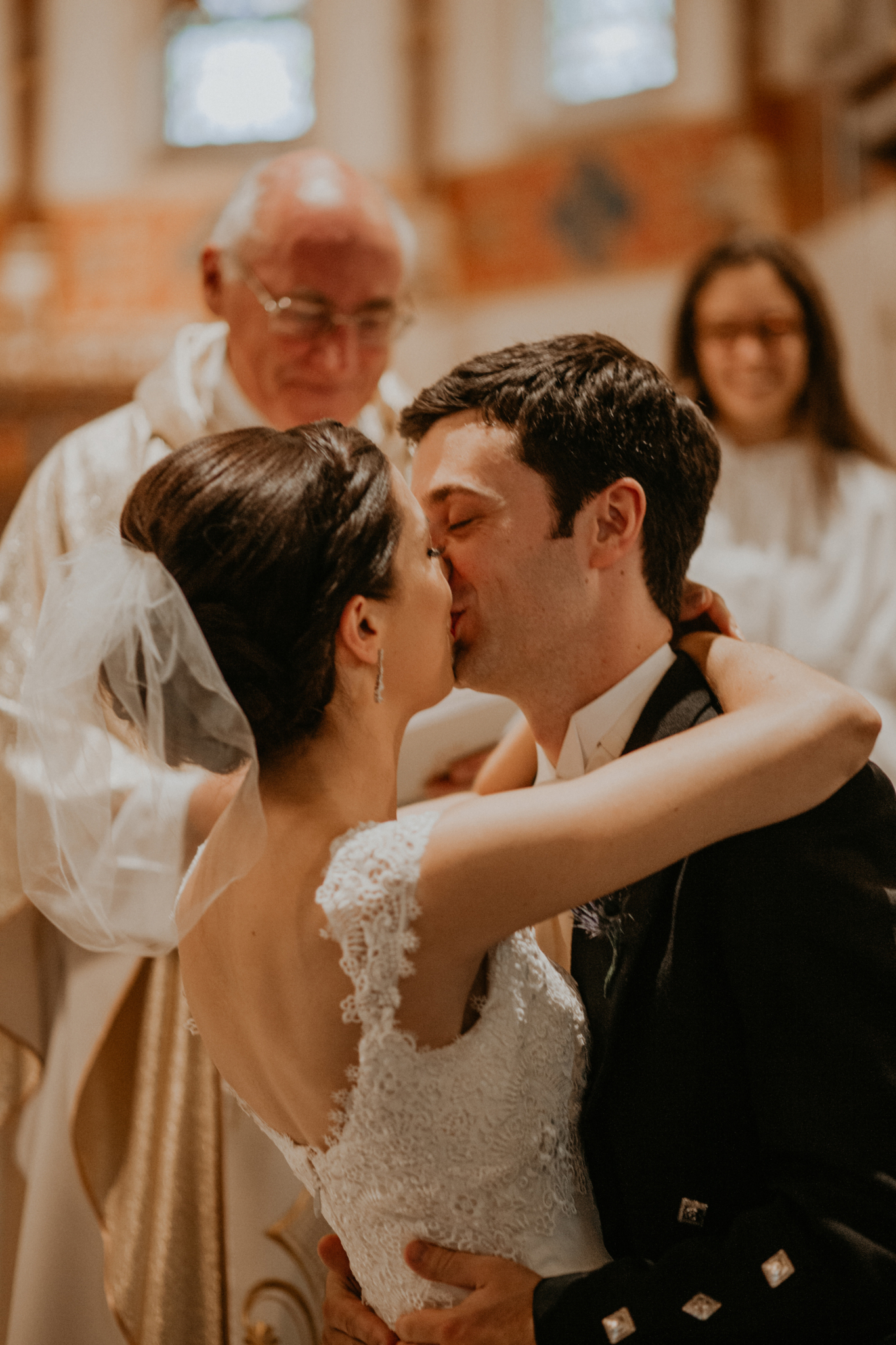 Bride and groom kissing in church romantic wedding photography