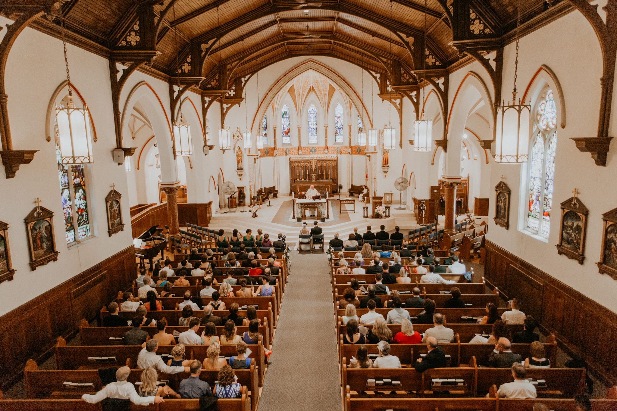 Wide angle photograph of wedding in traditional church