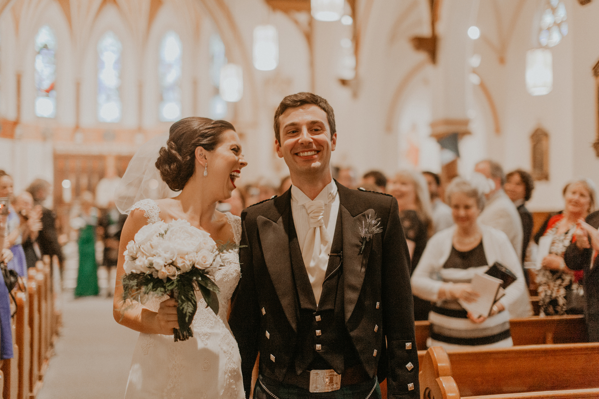 Bride and groom recessional in Scottish church wedding