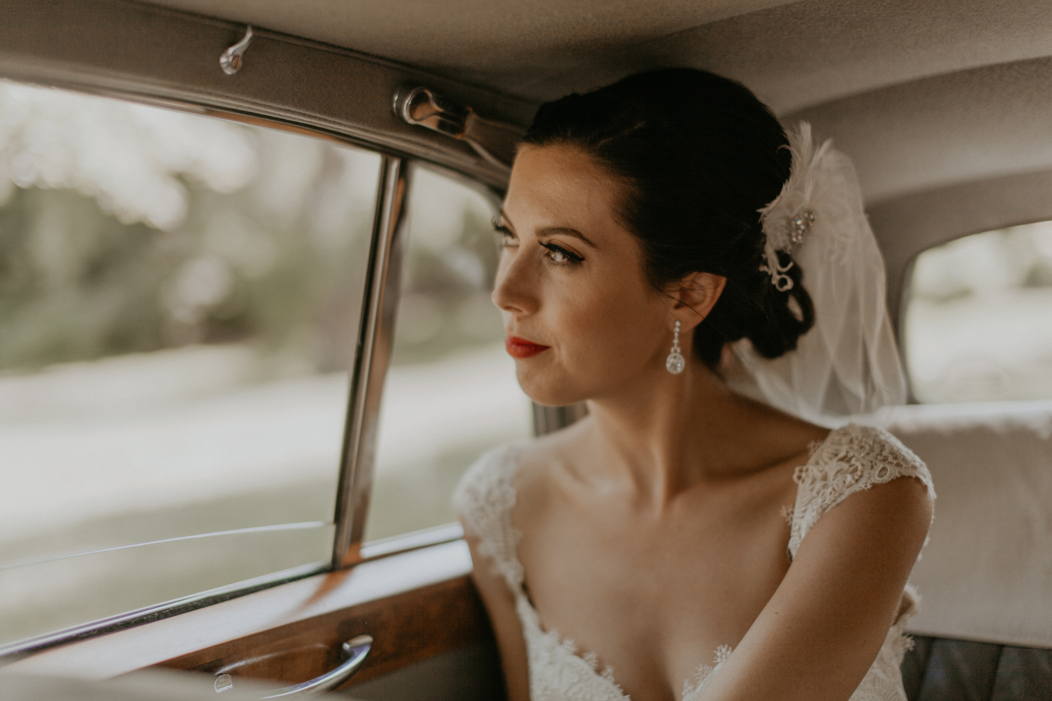 Candid documentary photo of bride riding in car