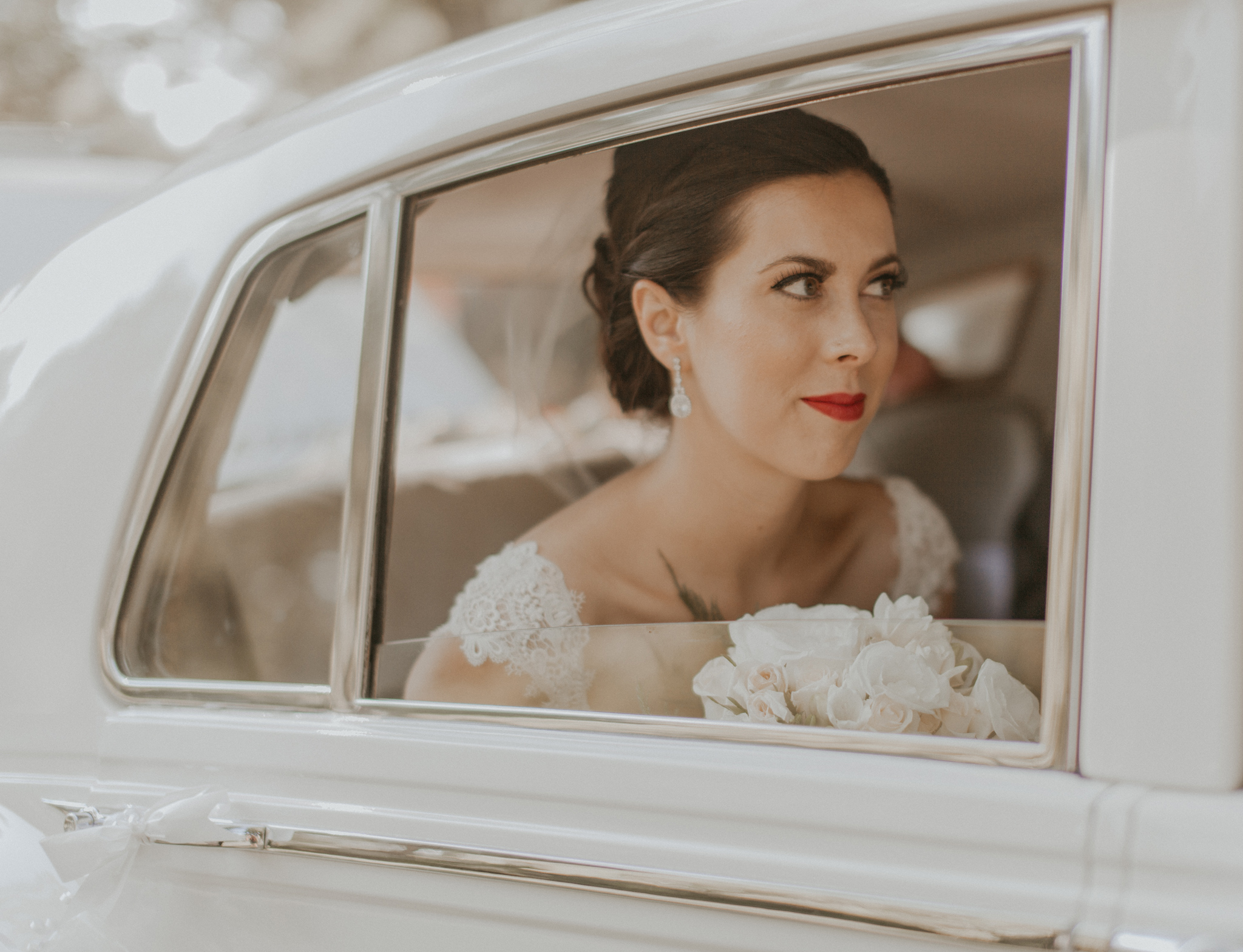 Picture of bride in car window on wedding day