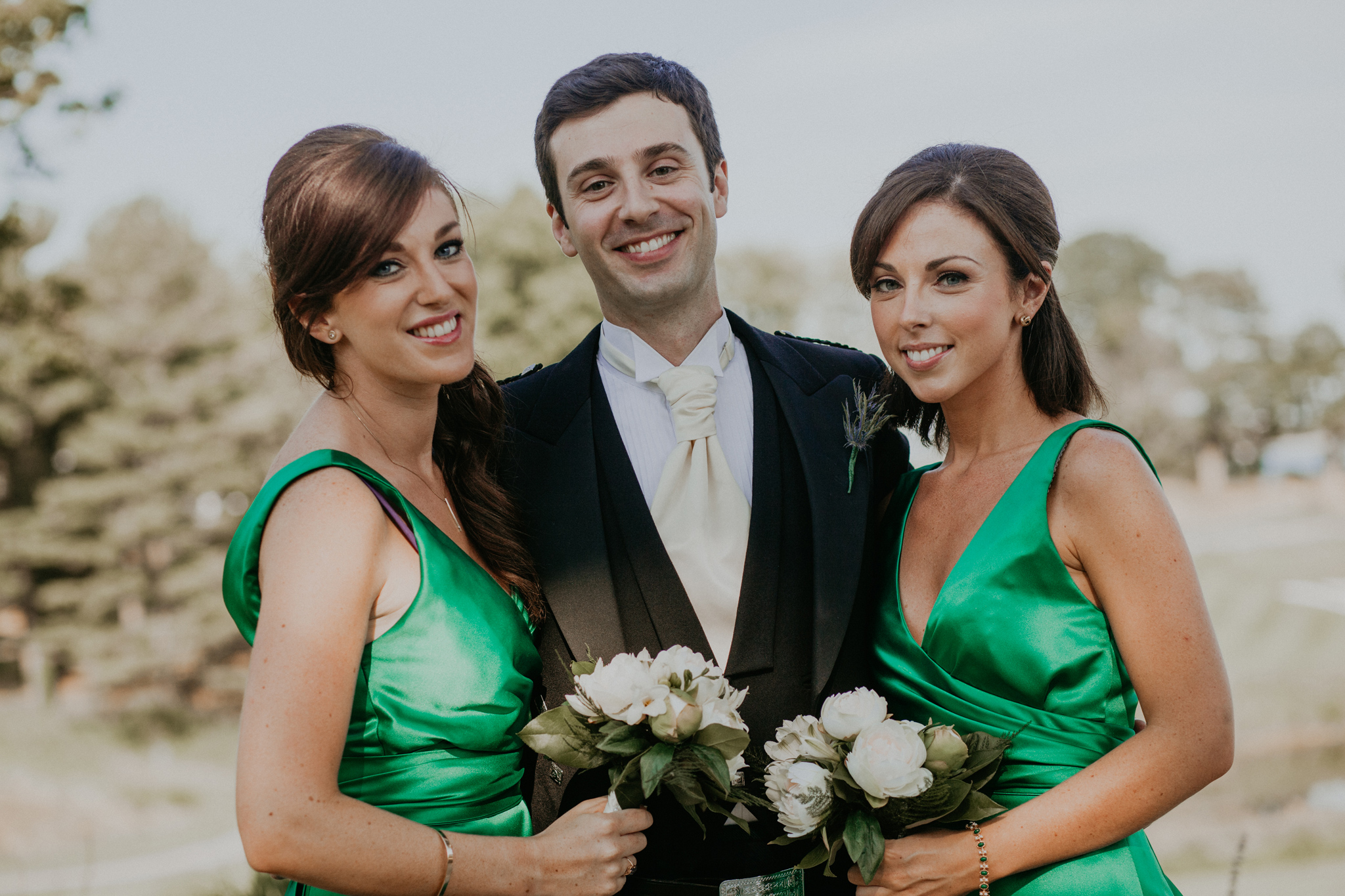 Family portraits at wedding groom with sisters
