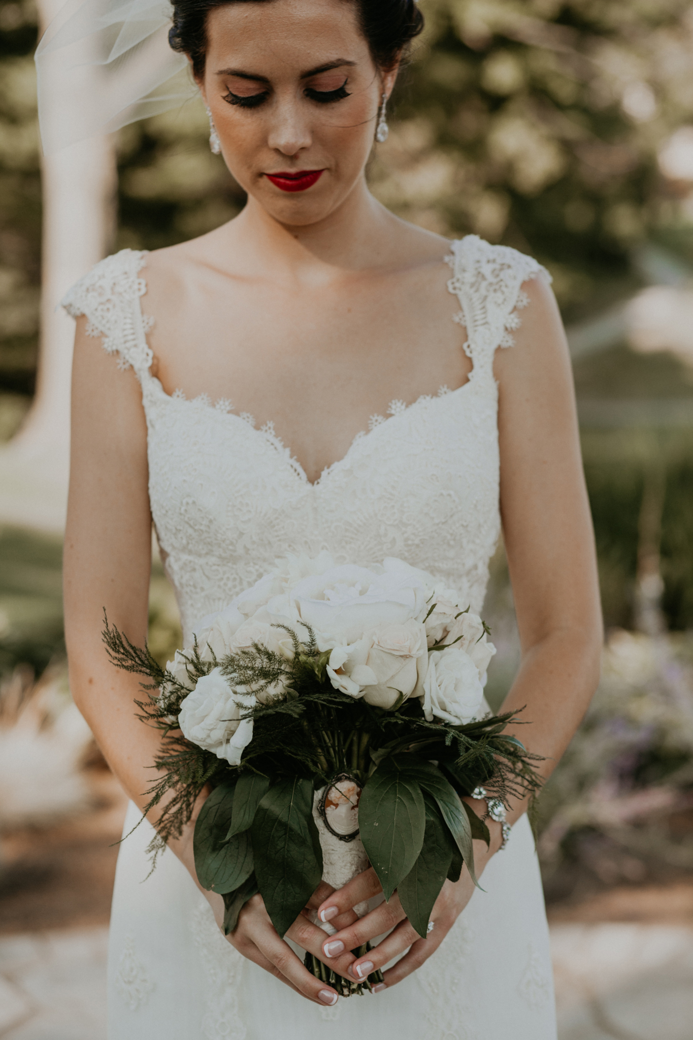 Close up portrait of bride holding bouquet