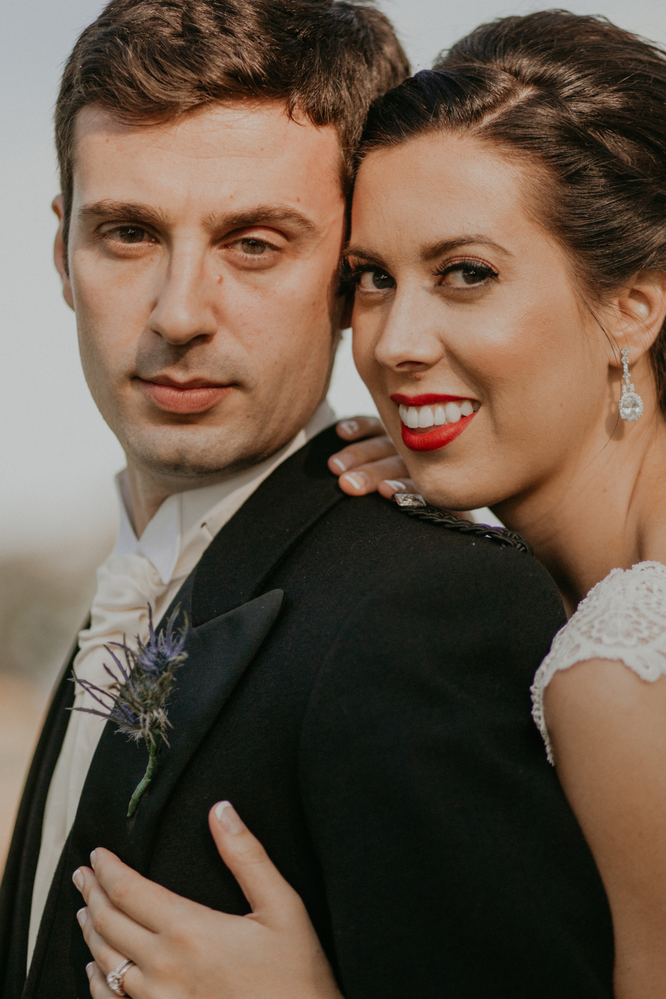 Portrait of bride and groom smiling close up romantic wedding photograph