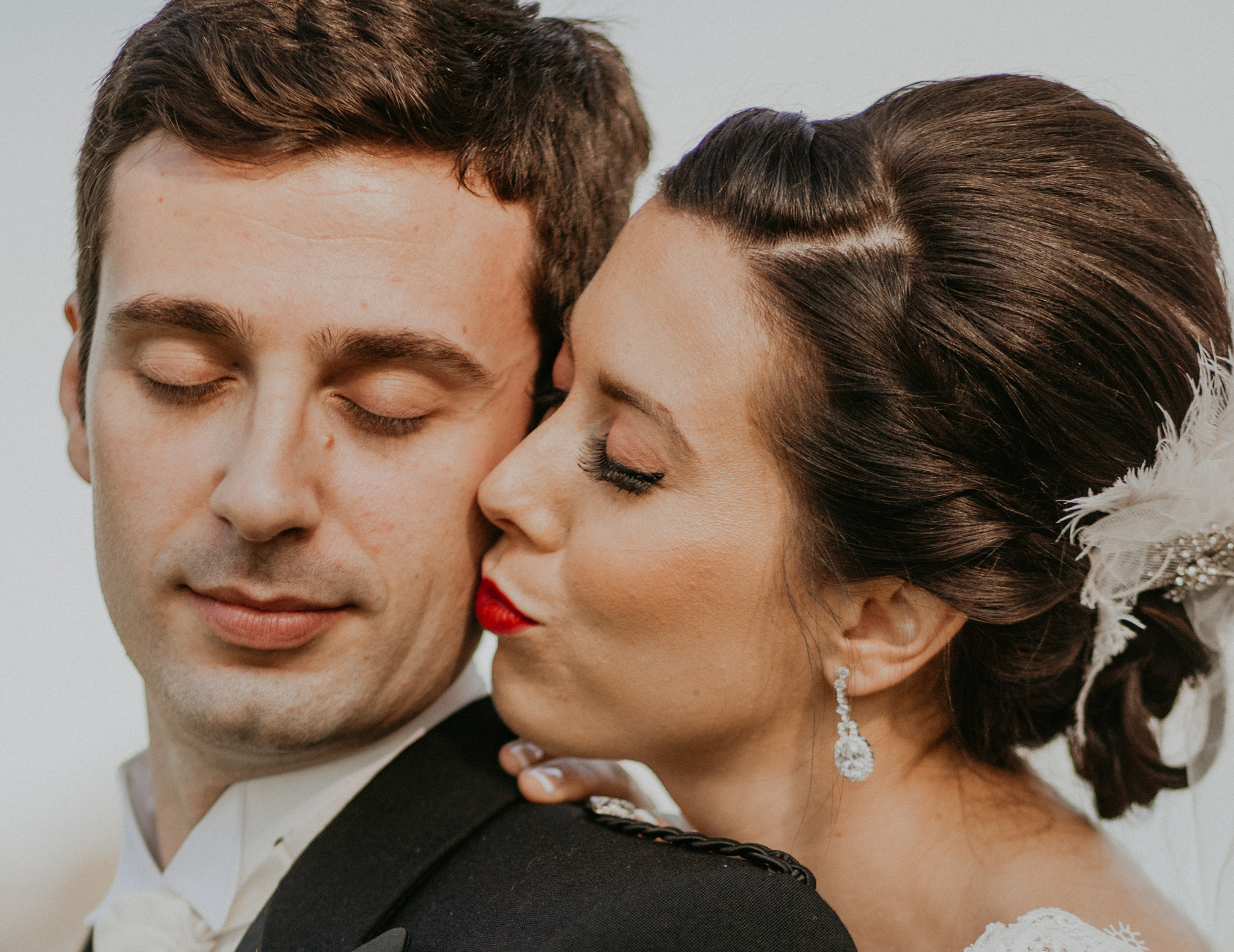 Bride kisses groom on cheek romantic wedding photo minneapolis mn