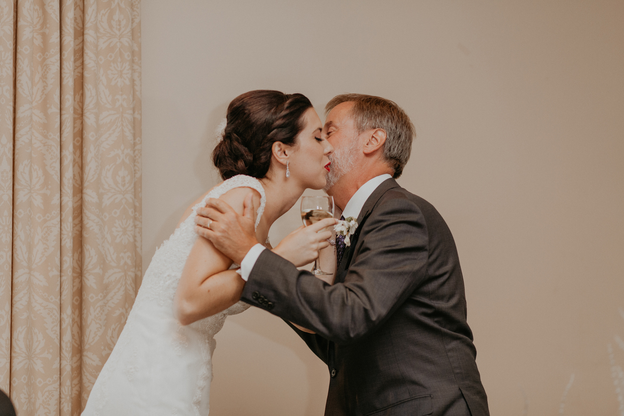 Bride kisses father after wedding speech in documentary wedding photo