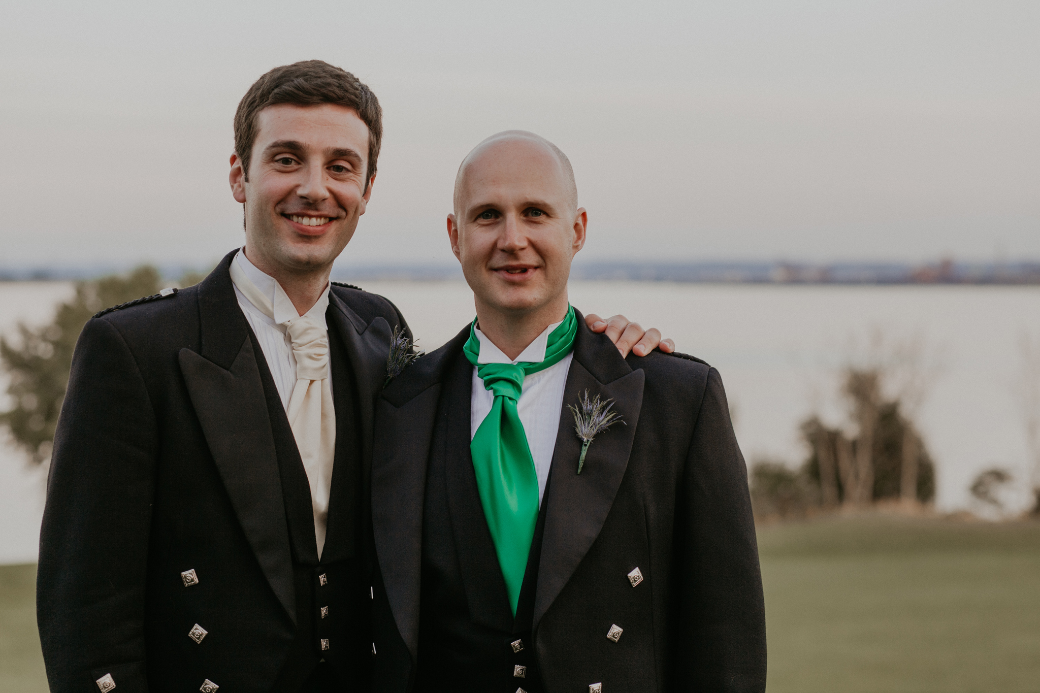 Portrait of groom with best man smiling