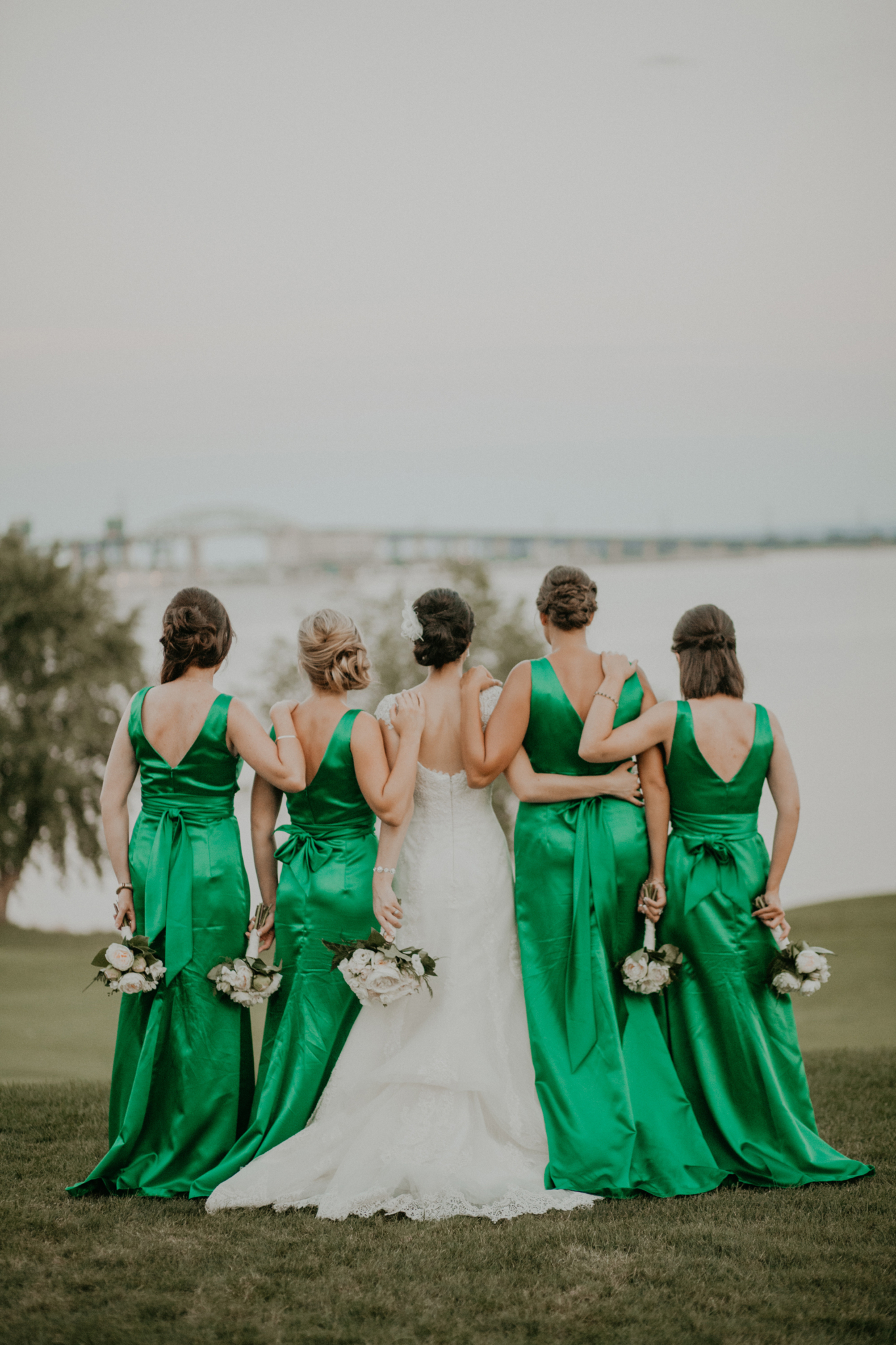 Portrait of bride and bridesmaids in green bridesmaids gowns