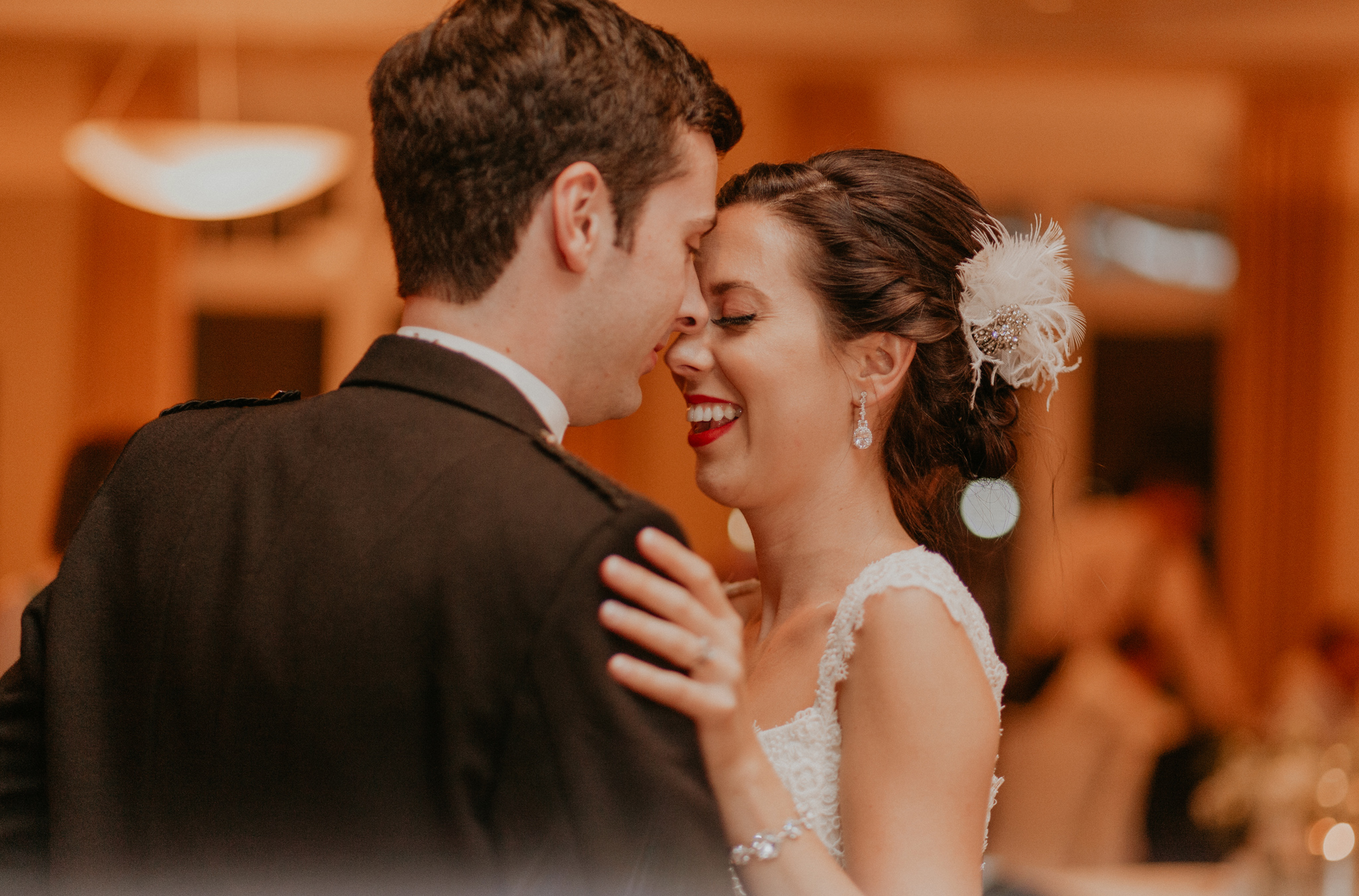 Bride and groom smile in candid documentary photograph picture during wedding reception