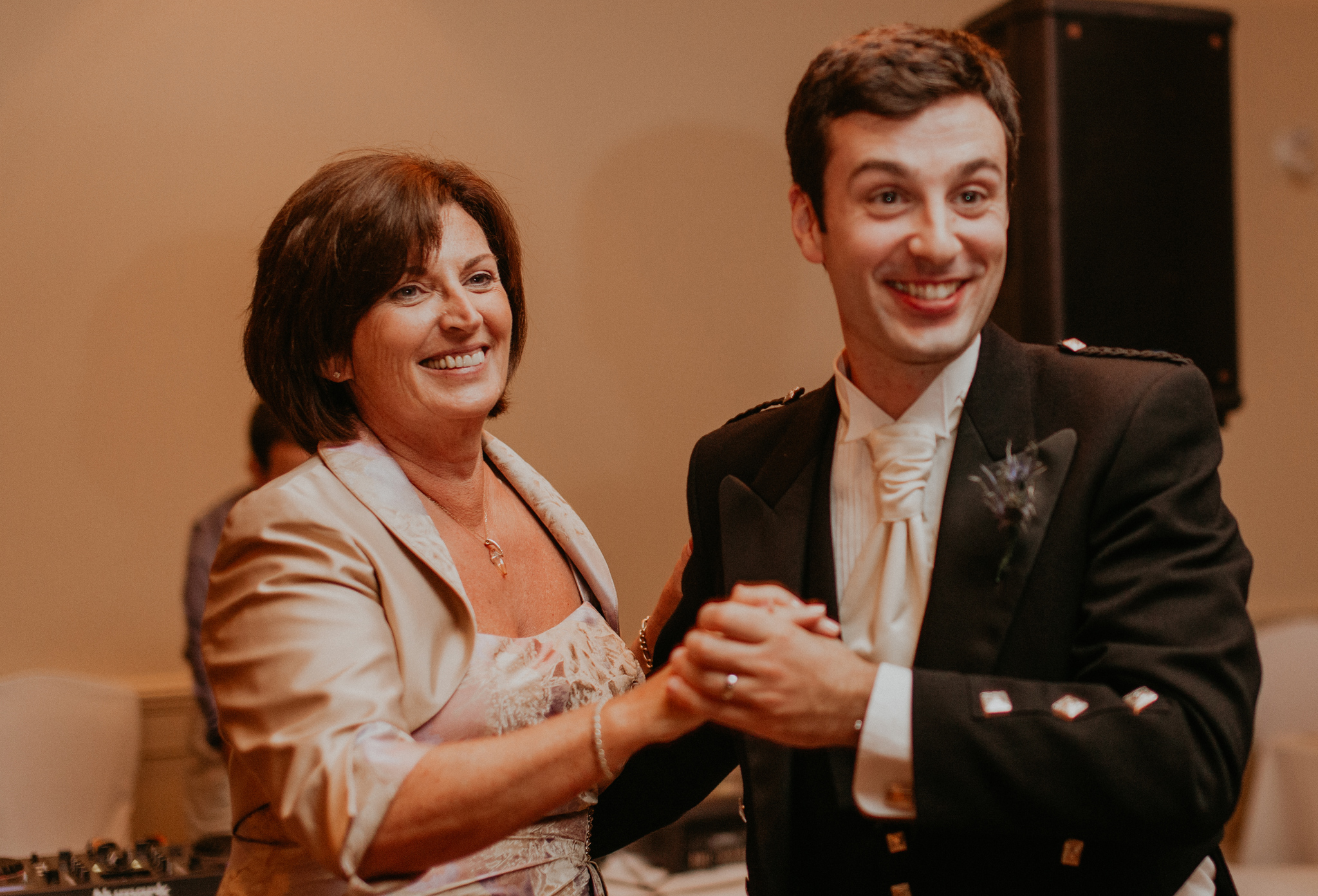 Groom dances with mom at wedding reception