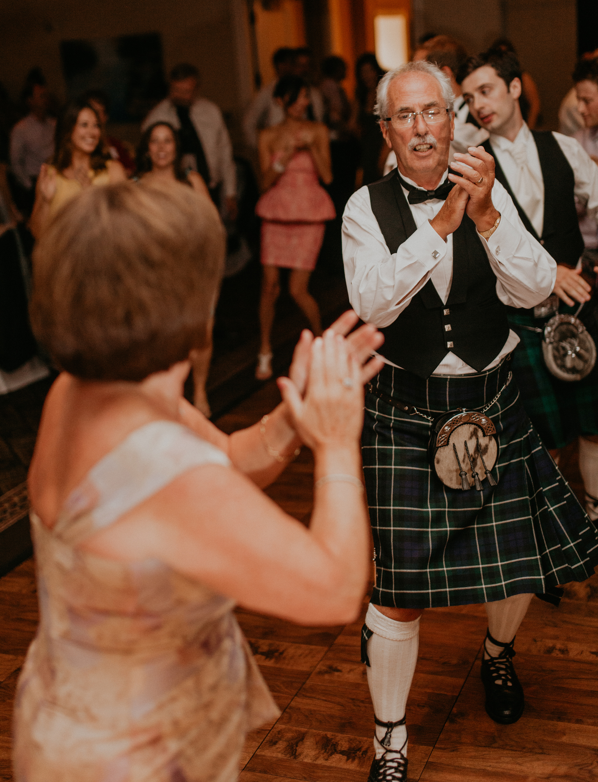 Father of the groom dances in kilt at wedding reception
