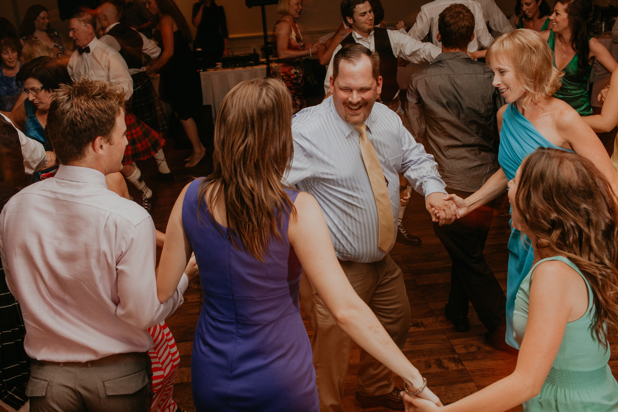 Guests dance at wedding during recpetion