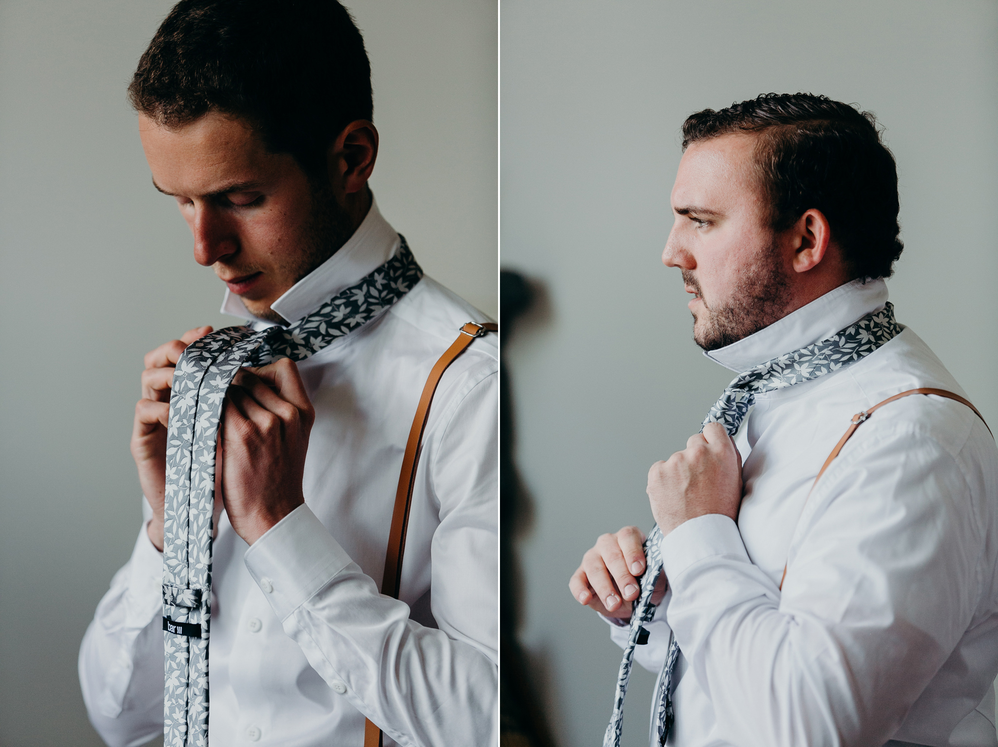 Groomsmen tying ties getting ready against white background