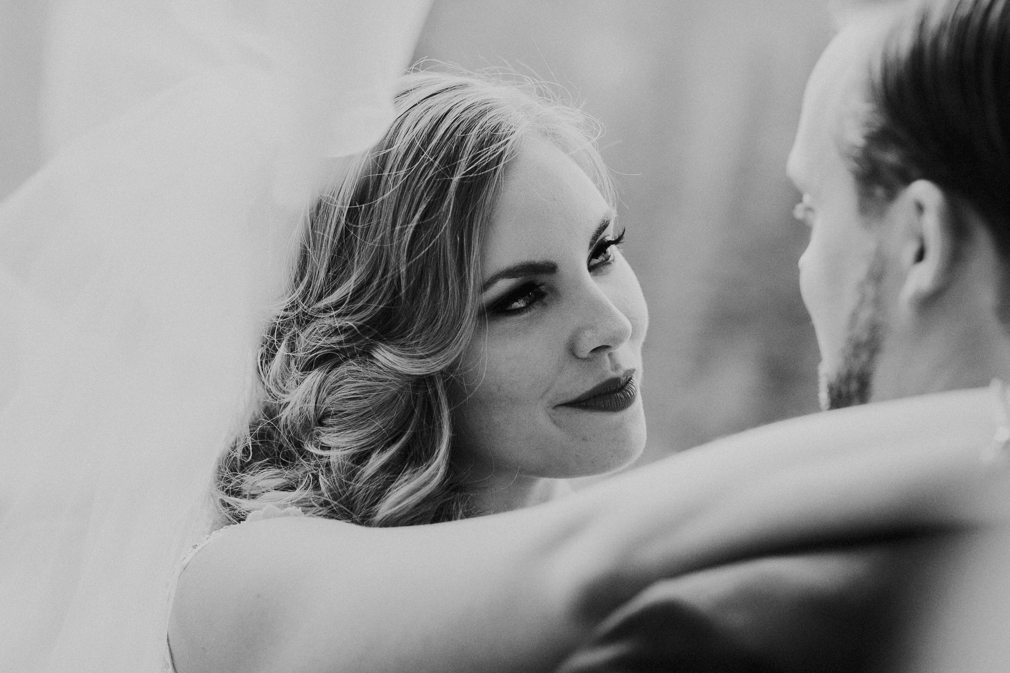 Close up of bride looking at groom in black and white