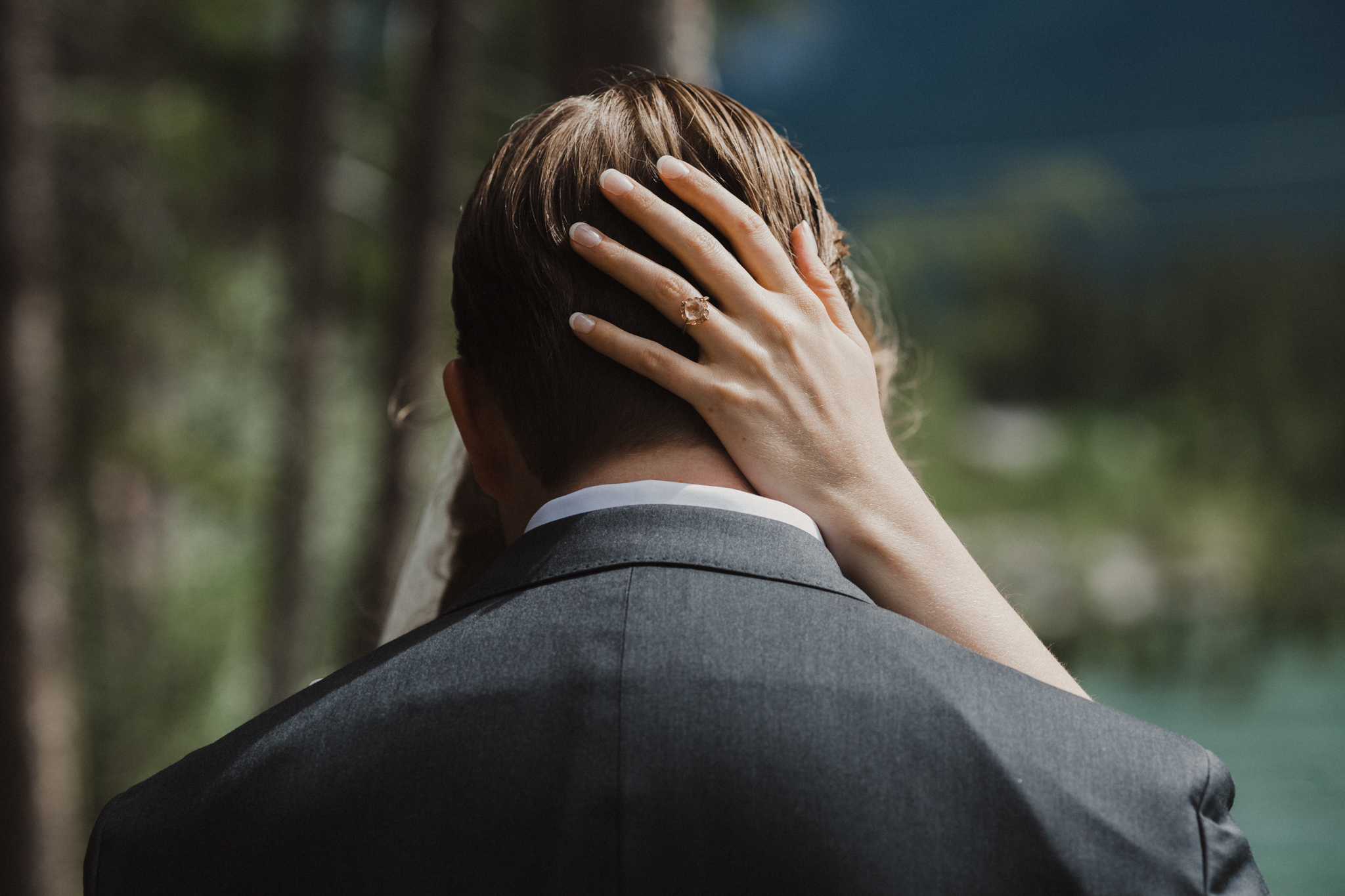 Close up of bride's wedding ring on back of groom's head romantic wedding detail