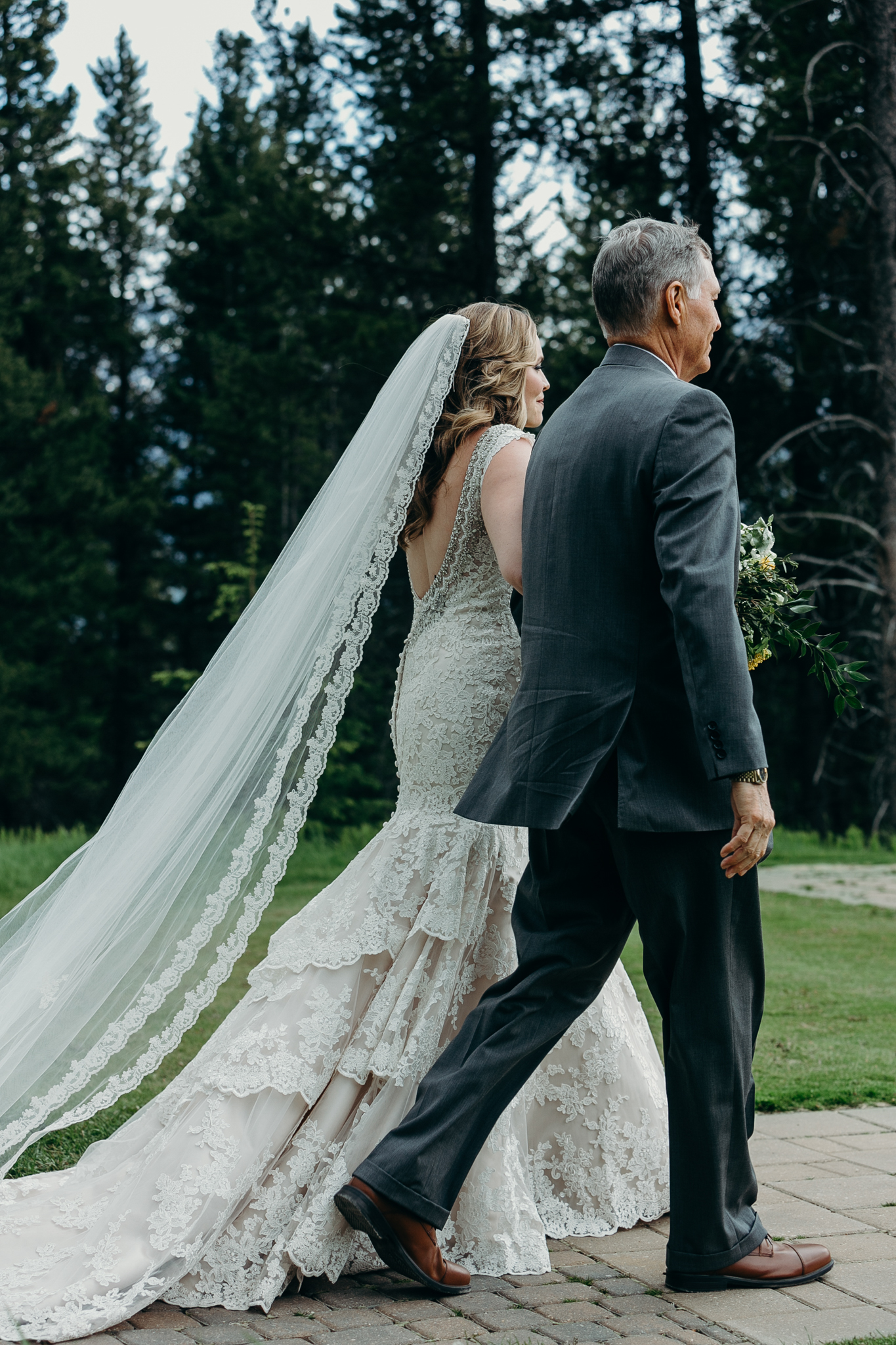 Father walks bride down aisle at Silvertip Resort Canmore AB wedding