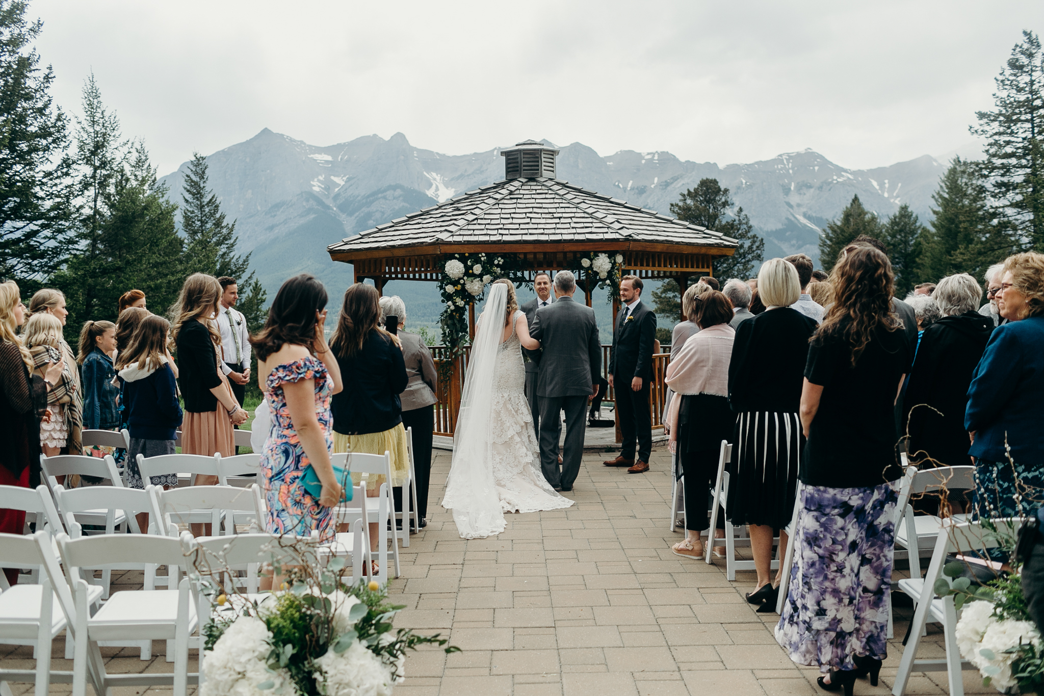 Wedding ceremony at gazebo Silvertip Resort Canmore Alberta