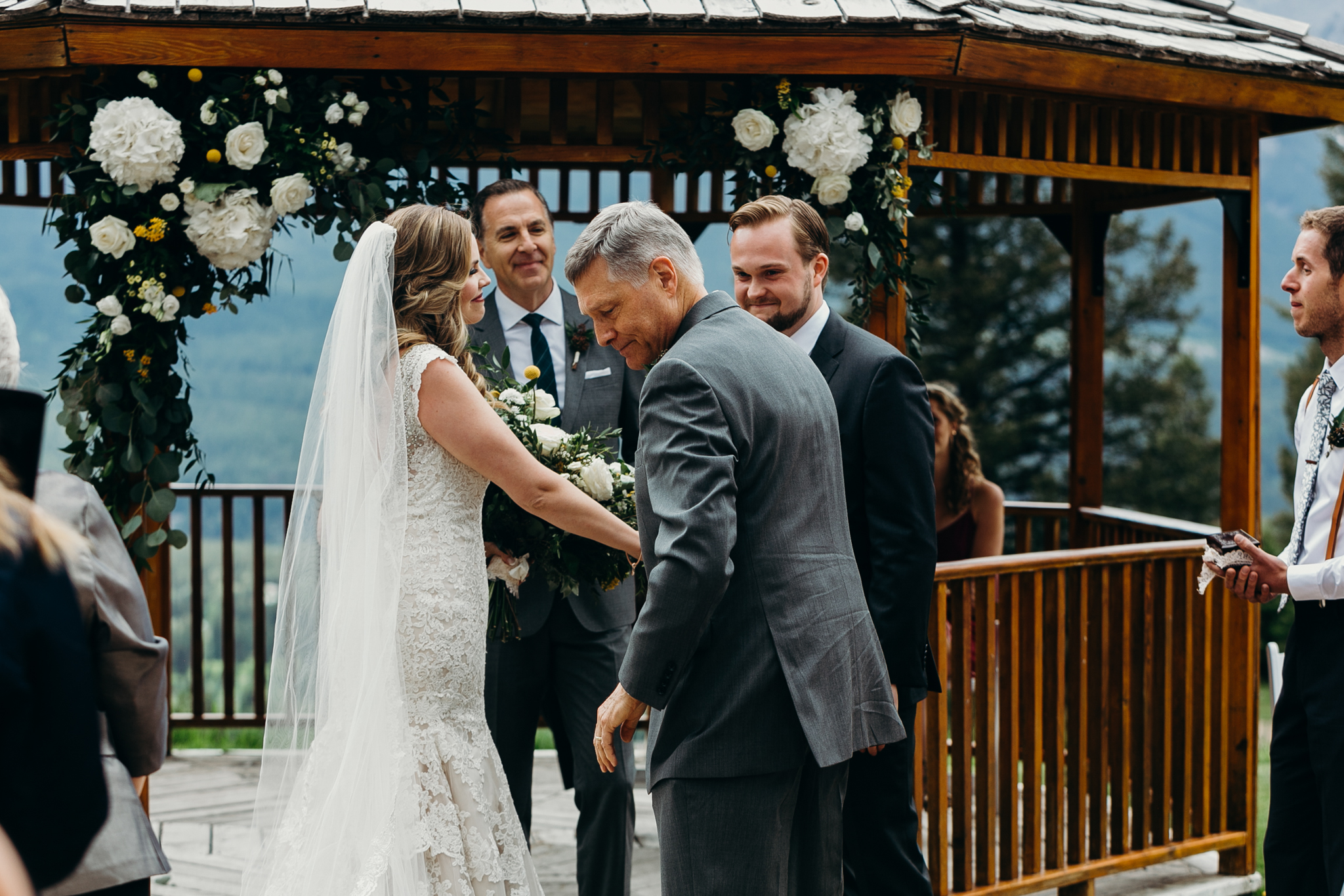 Father gives away bride at Silvertip Resort gazebo Canmore Alberta