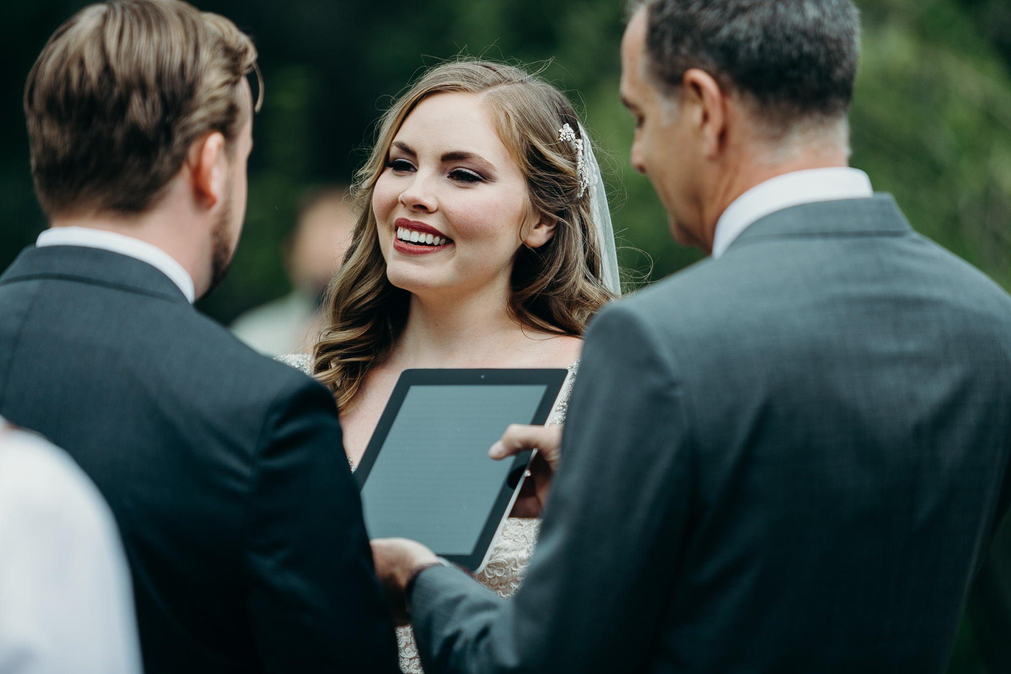 Bride smiles at groom Silvertip Resort wedding ceremony in Canmore Alberta