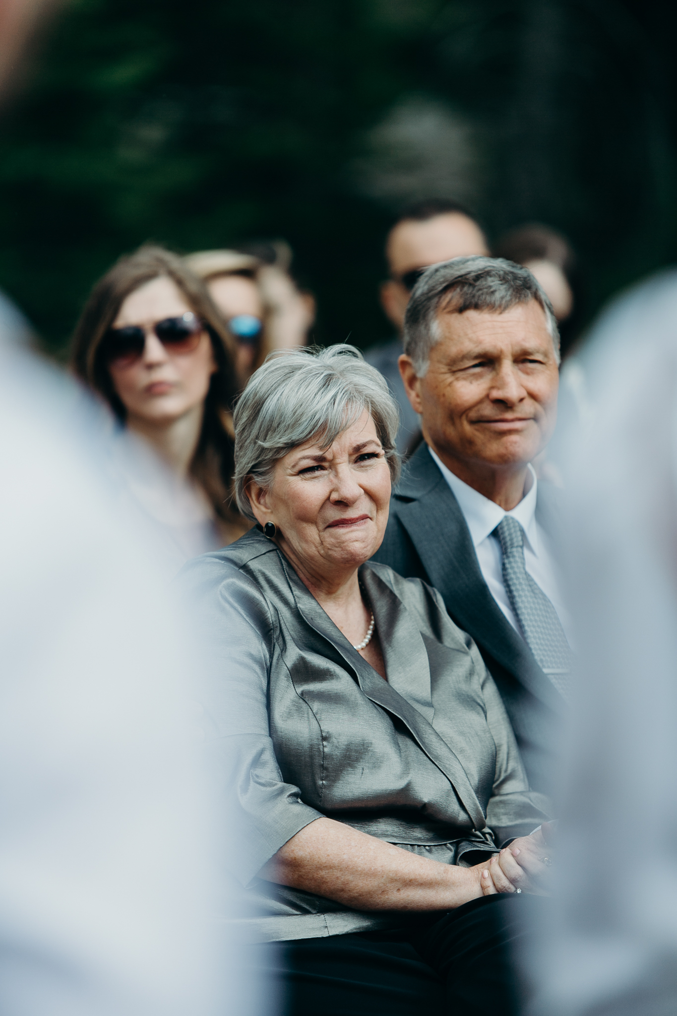 documentary photo candid parents of groom Silvertip Resort wedding ceremony in Canmore Alberta