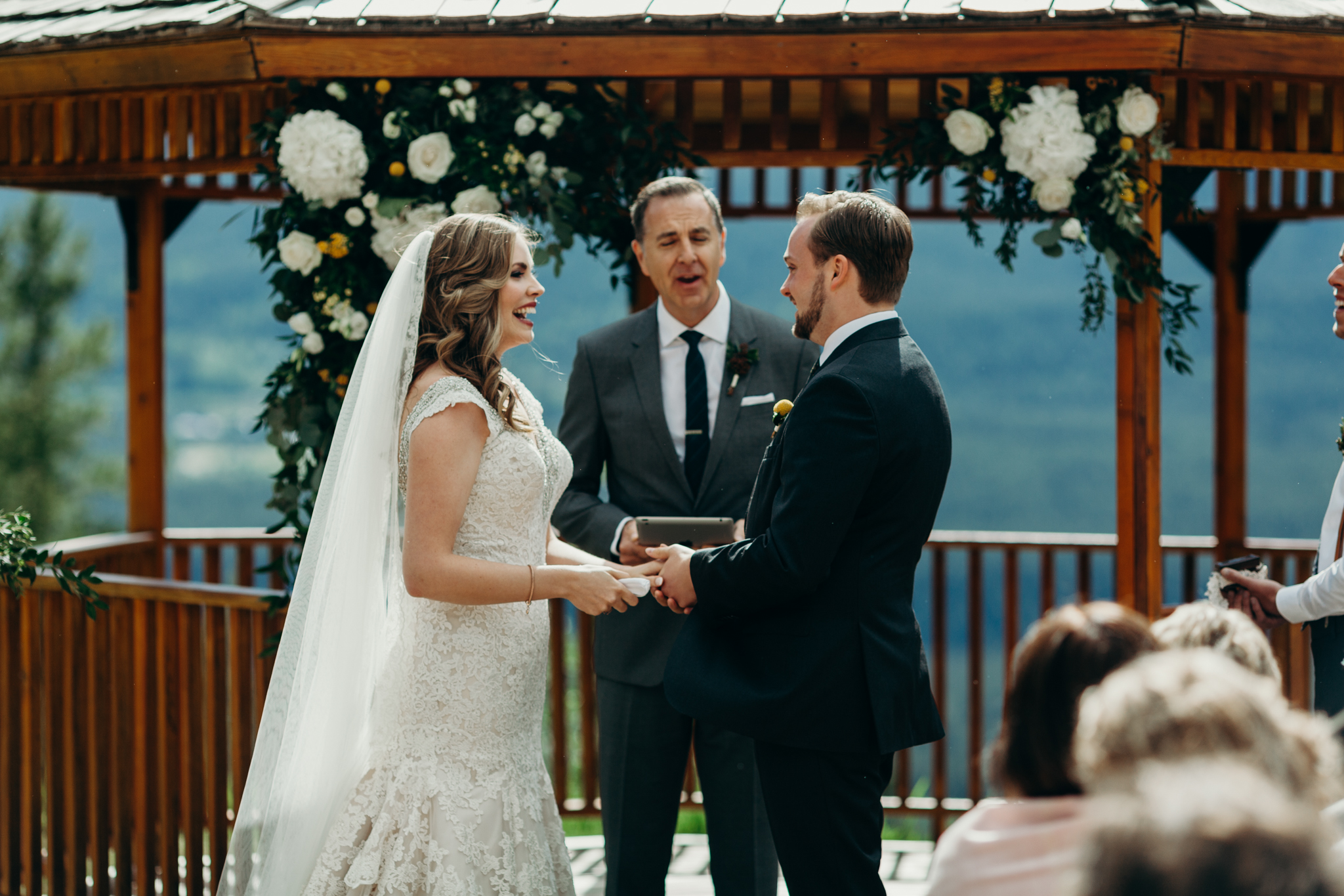 Bride and groom in front of gazebo at Silvertip Resort Canmore Alberta