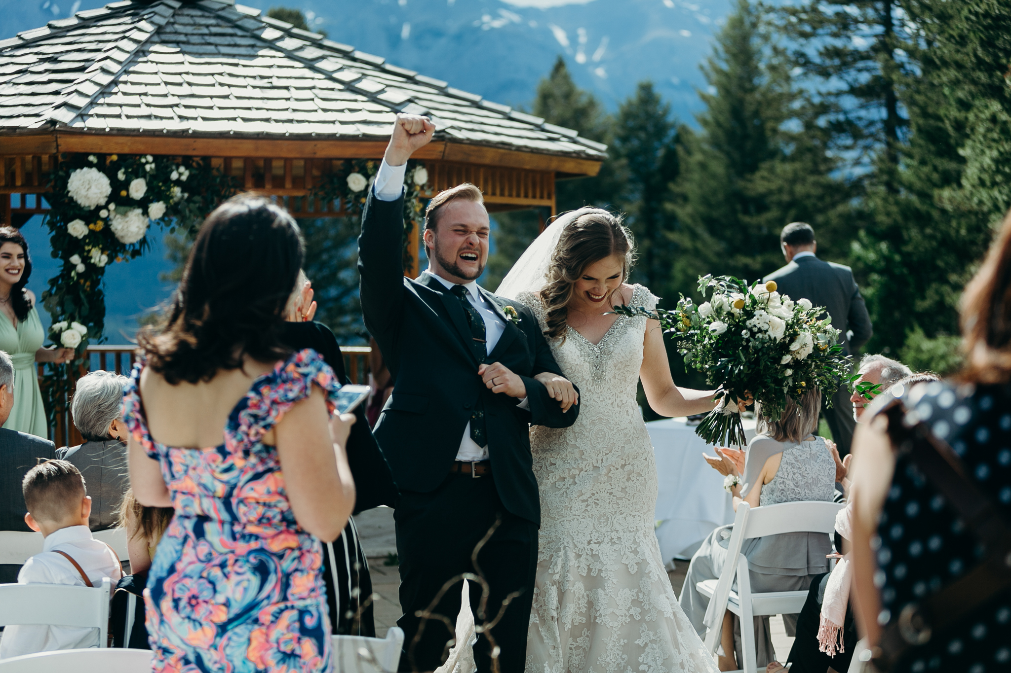 Bride and groom celebrate Wedding ceremony at gazebo Silvertip Resort Canmore AB rocky mountain wedding