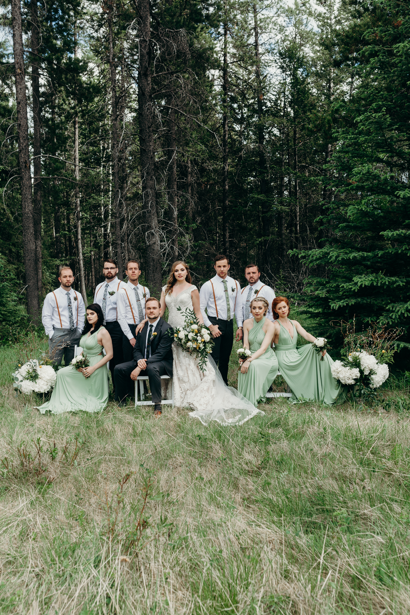 Wedding party photo with mountains at Silvertip Resort destination wedding Canmore AB