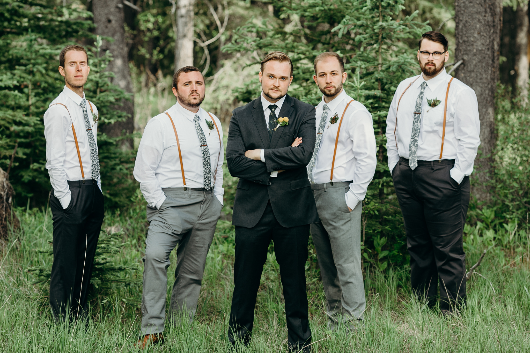 Groomsmen pose for picture at Silvertip Resort destination wedding Canmore AB