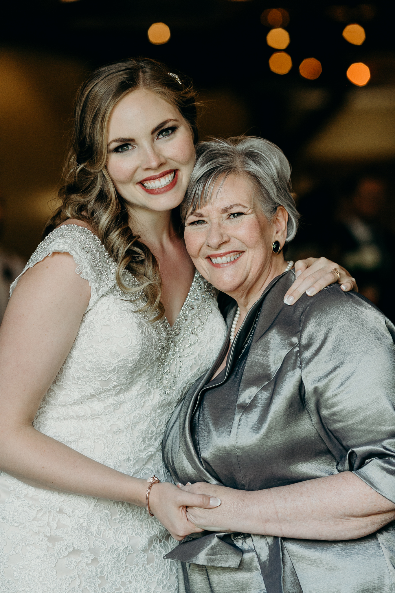 Bride and mom pose for picture Silvertip Resort wedding Canmore Alberta