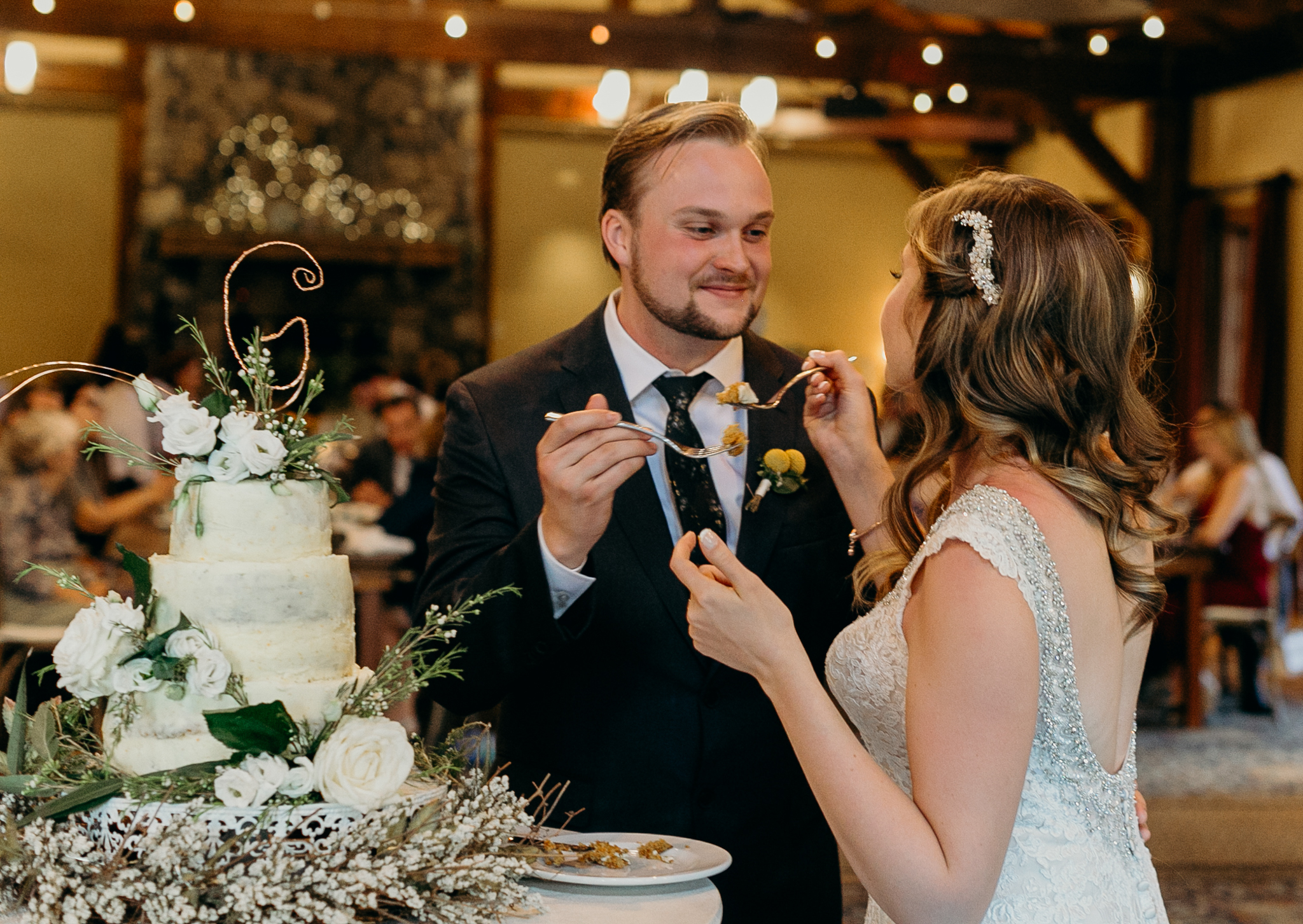 Bride and groom cut cake at Silvertip Resort Wedding reception