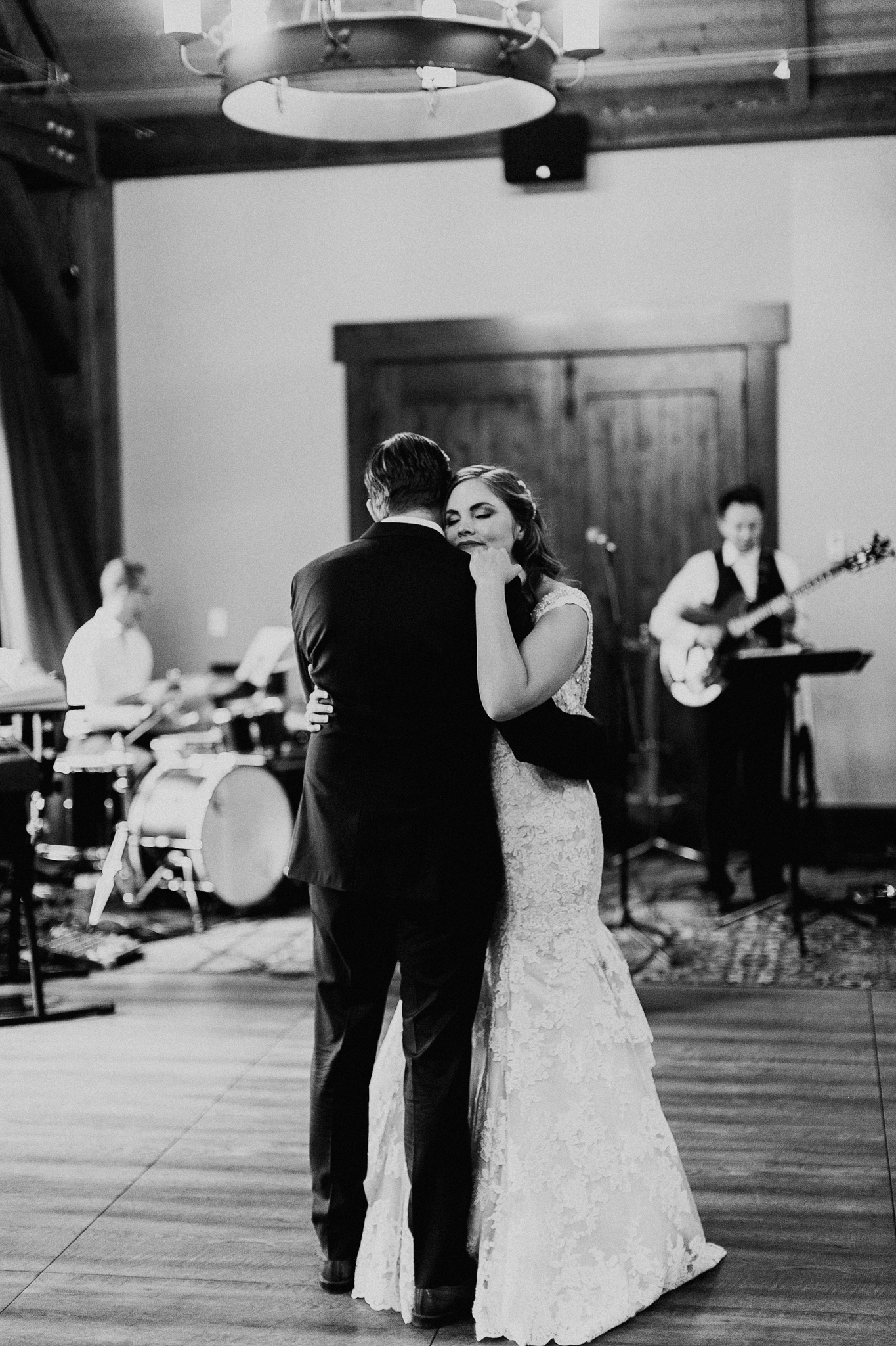 Bride and groom dance during wedding reception at Silvertip Resort in Canmore Alberta romantic wedding photograph MN