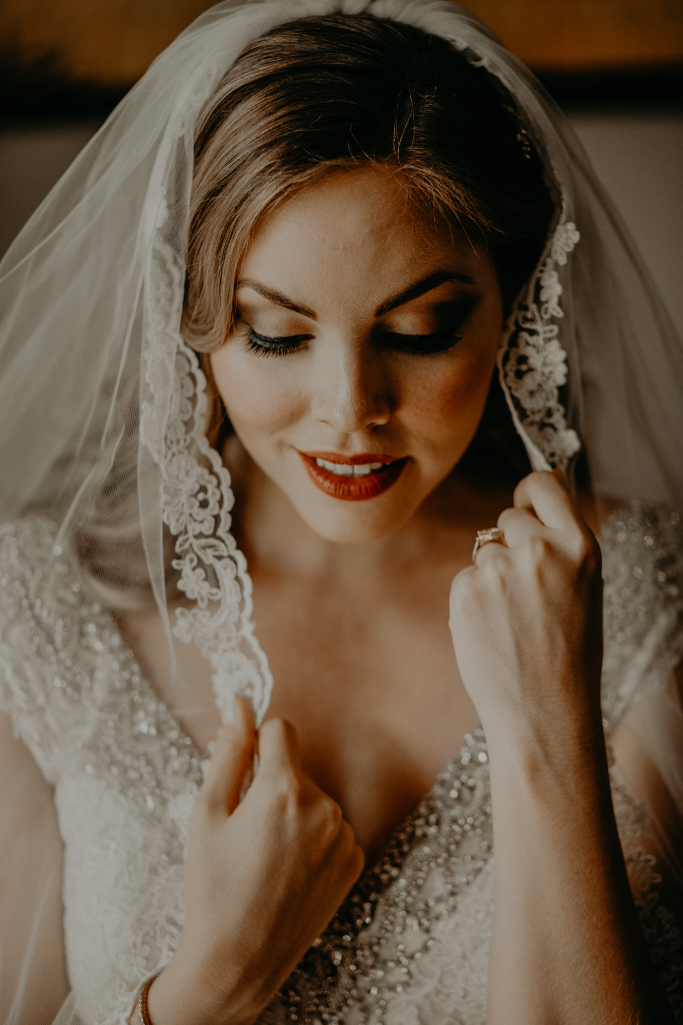 Portrait of bride touching veil MN wedding photographer