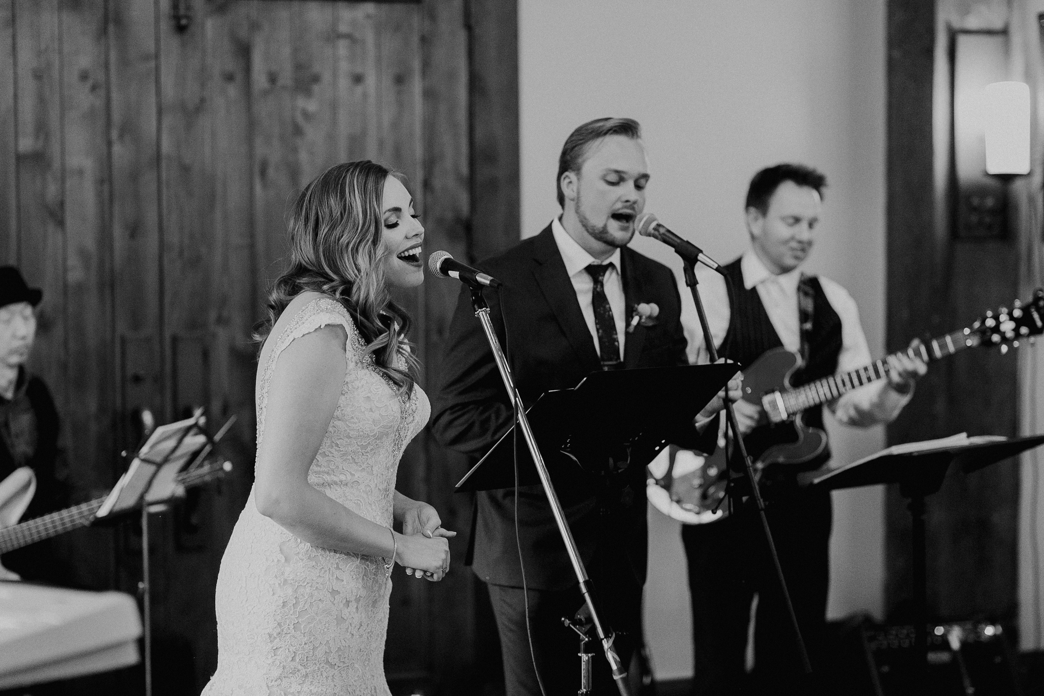 Bride and groom sing at wedding reception candid documentary photographer MN
