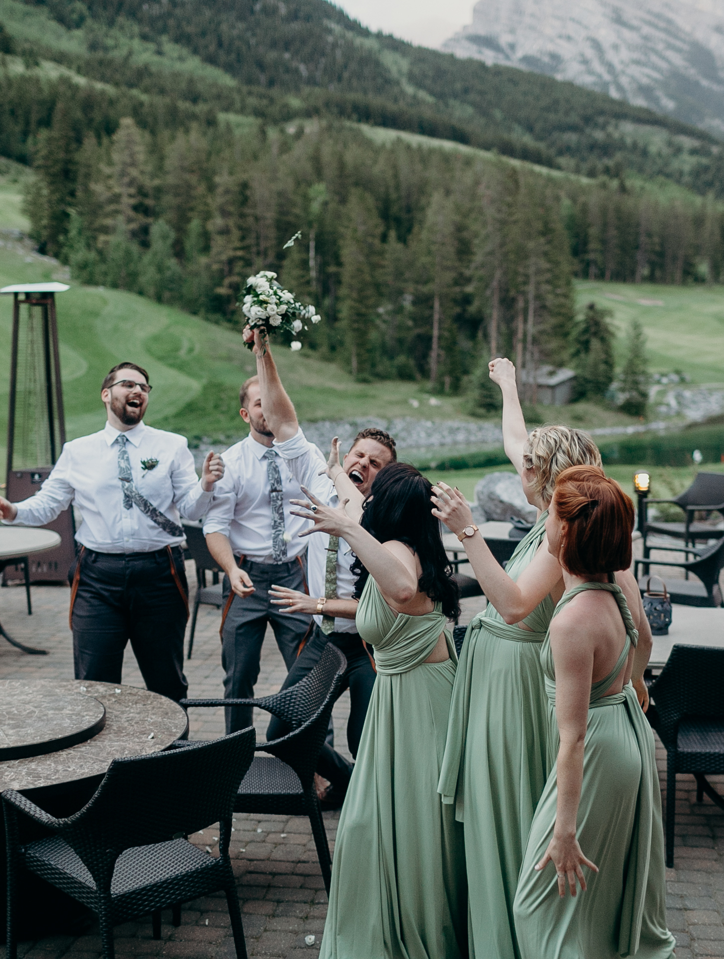 Wedding reception bouquet toss Silvertip Resort Canmore Alberta destination wedding photograph