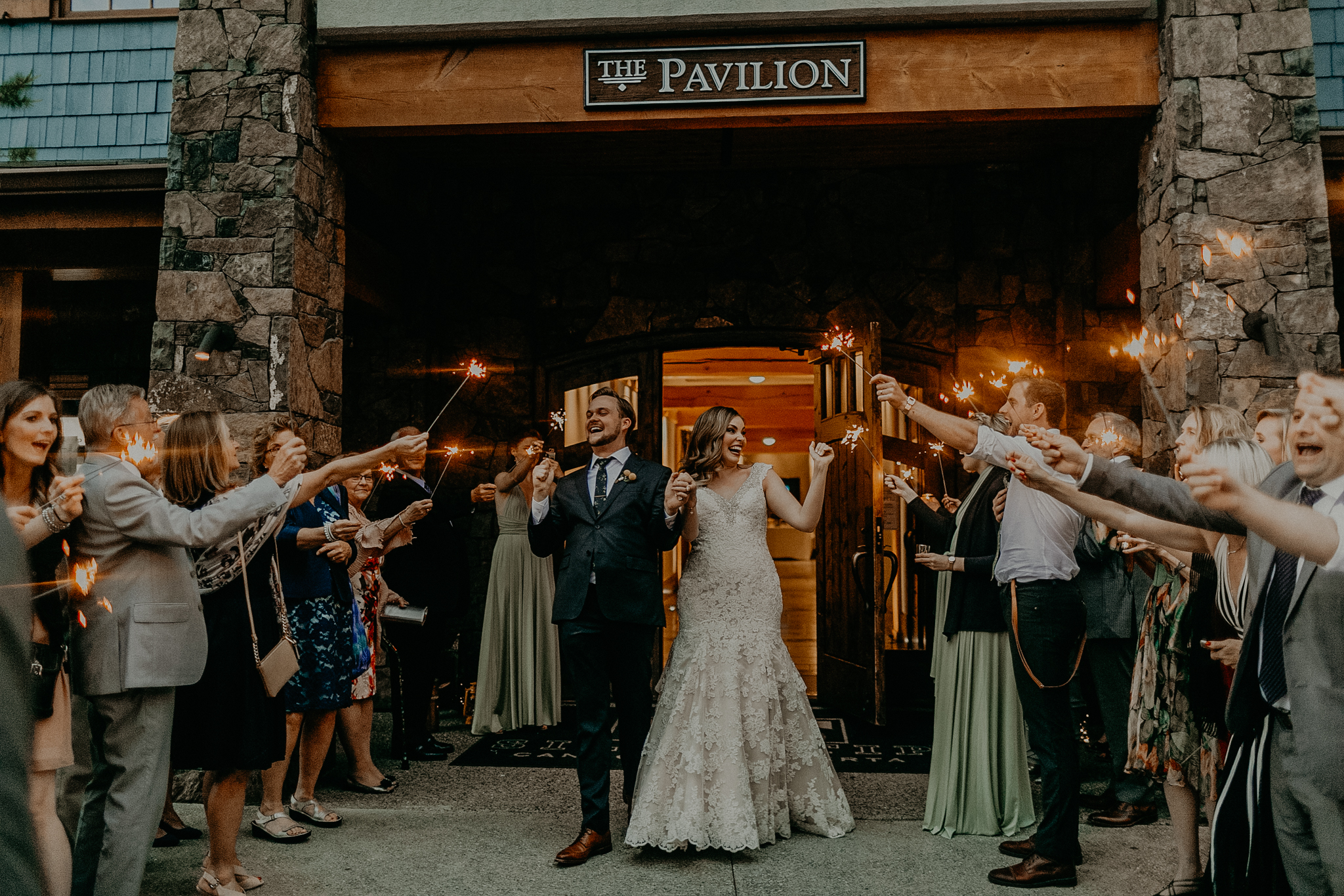 Candid wedding photograph of bride and groom with sparklers