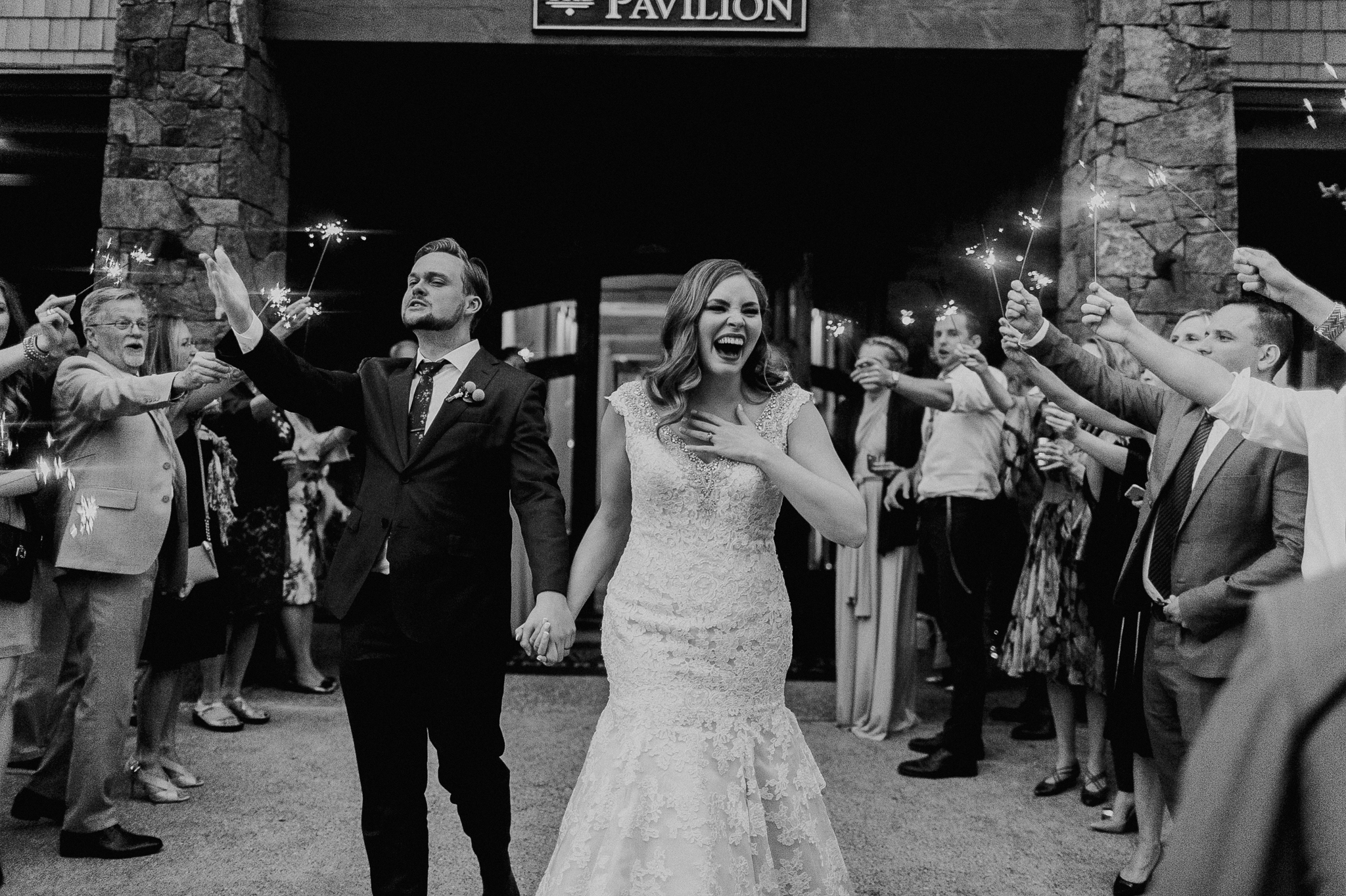documentary wedding photograph of bride and groom leaving reception