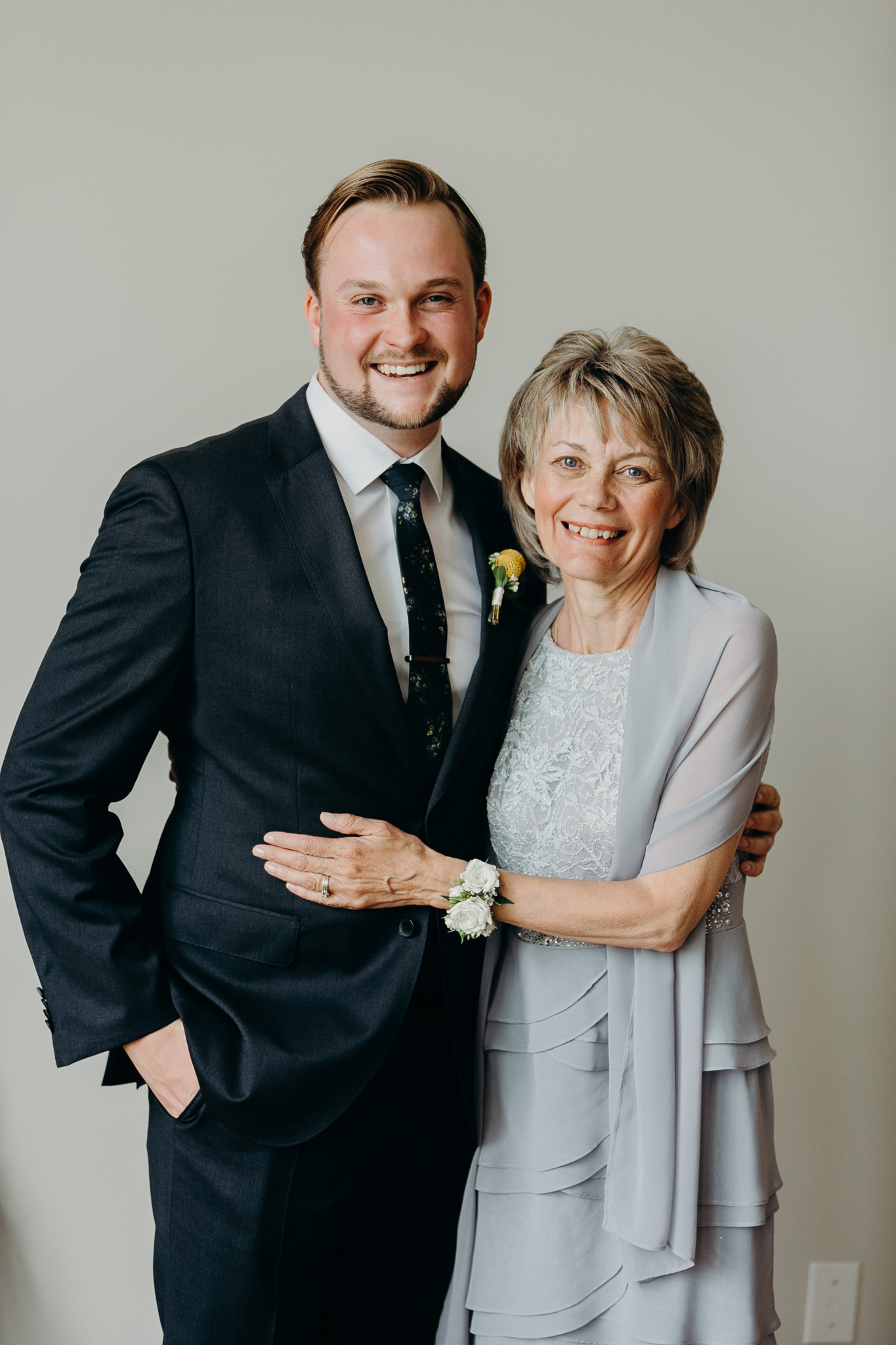 Portrait of groom and his mother smiling and embracing family wedding photography MN