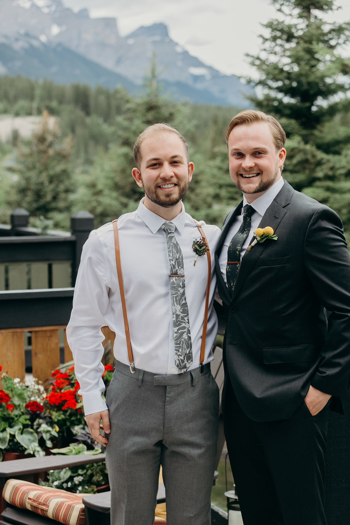 Groom and groomsman portrait smiling destination wedding photographer Canmore Banff