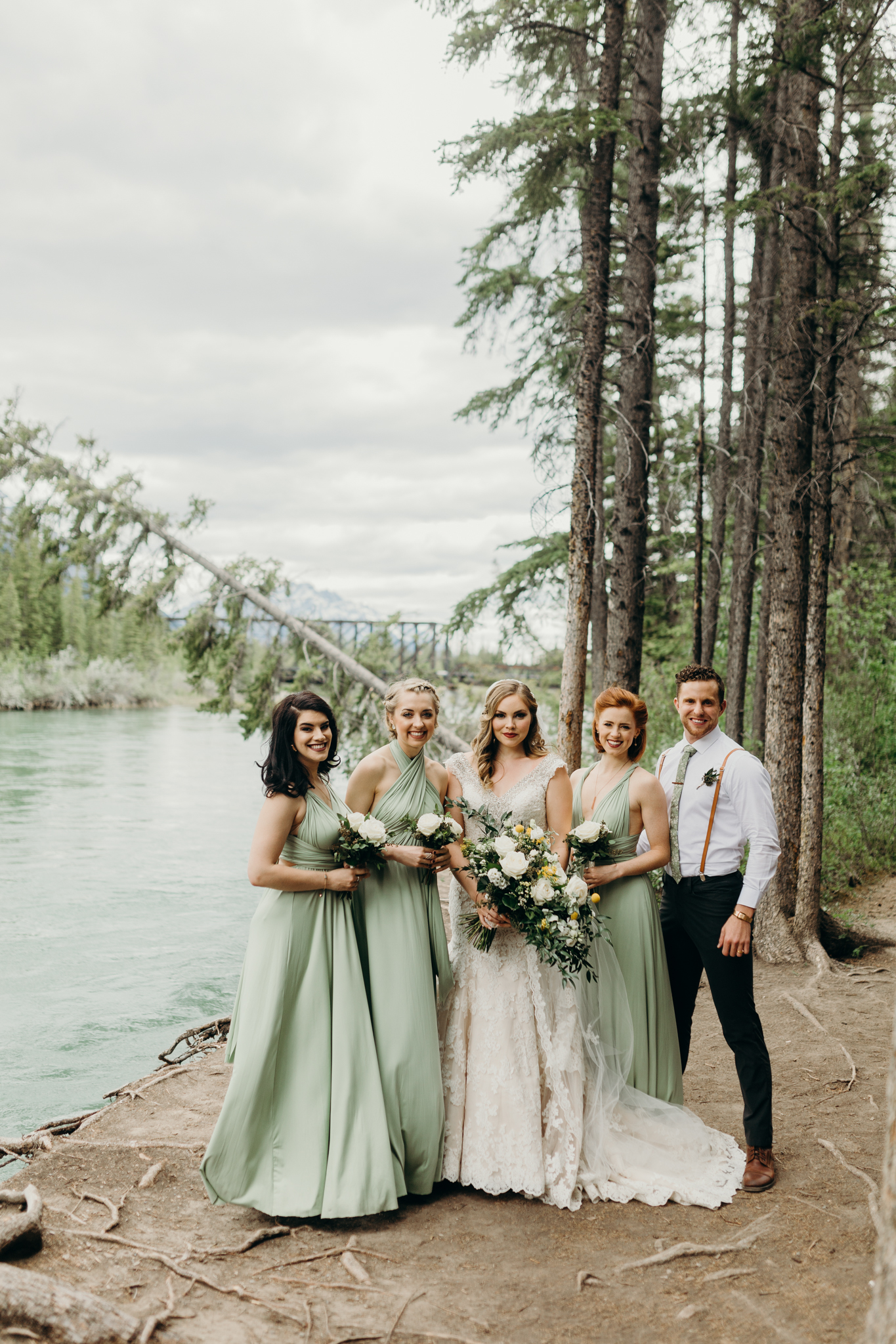 Brides and bridesmaids portrait at Bow River Canmore destination wedding