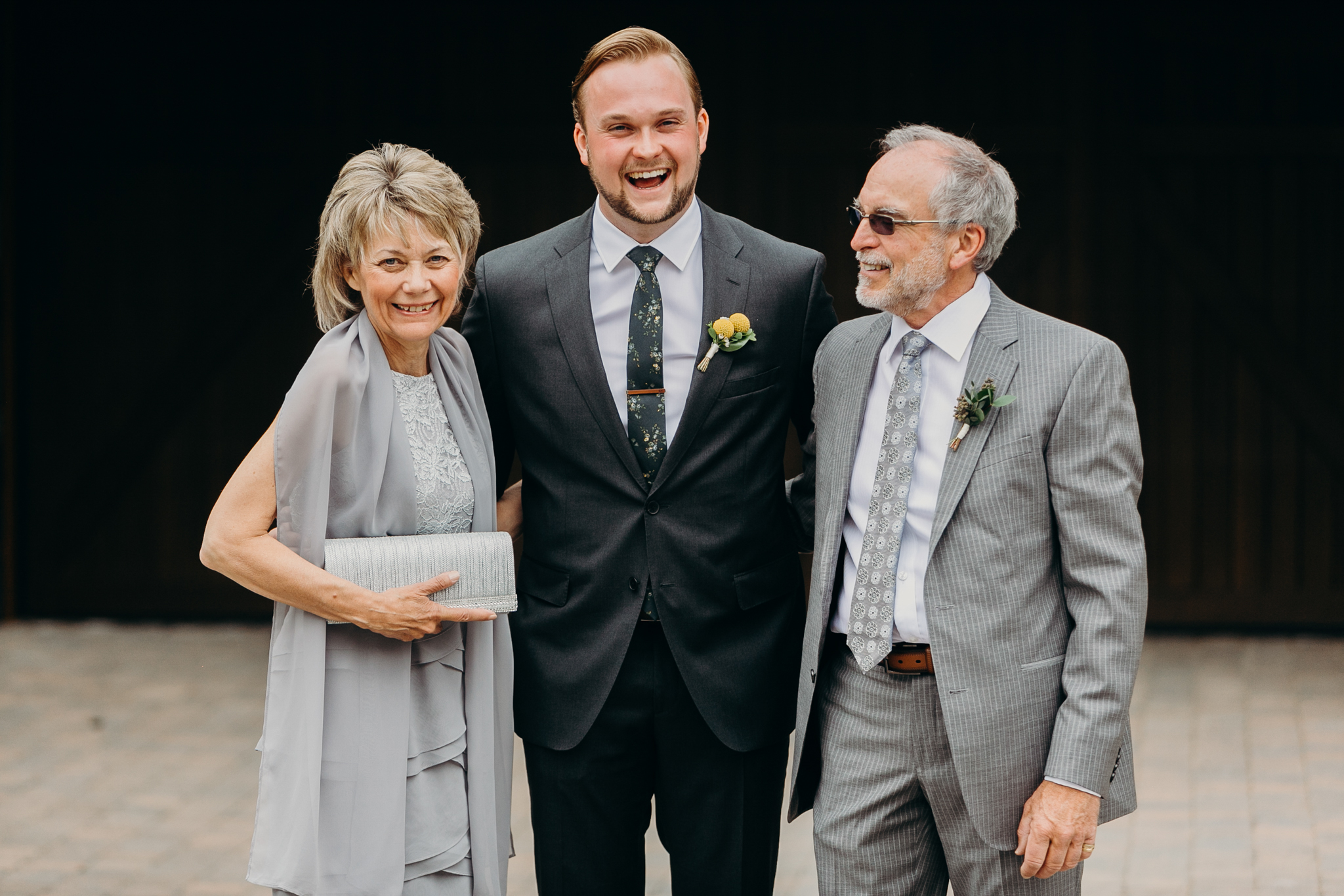 documentary wedding photograph of groom with mother and father Canmore Alberta