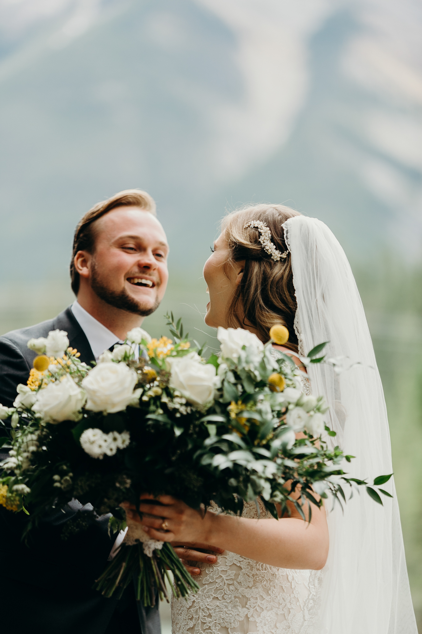 Bride and groom embrace romantic wedding photography MN destination wedding photographer Canmore AB