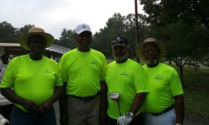 Sickle Cell Anemia Golf Tourney wearing Green Life shirts