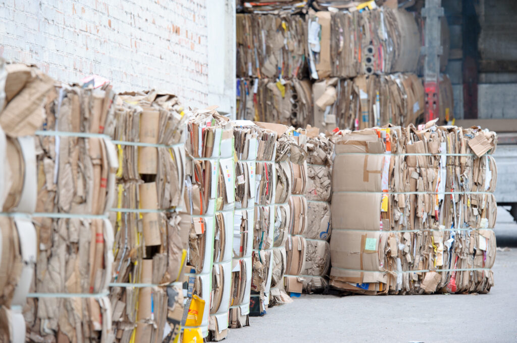 Waste paper collection and bundling for recycling.