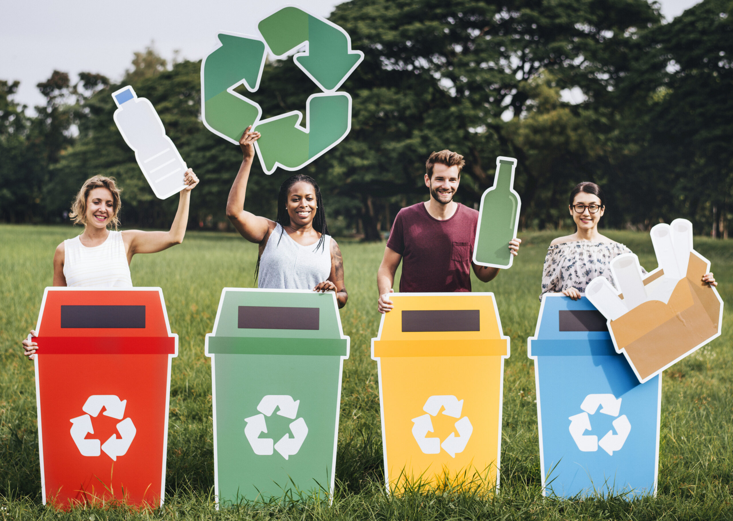 Group of people in front of recycling bins